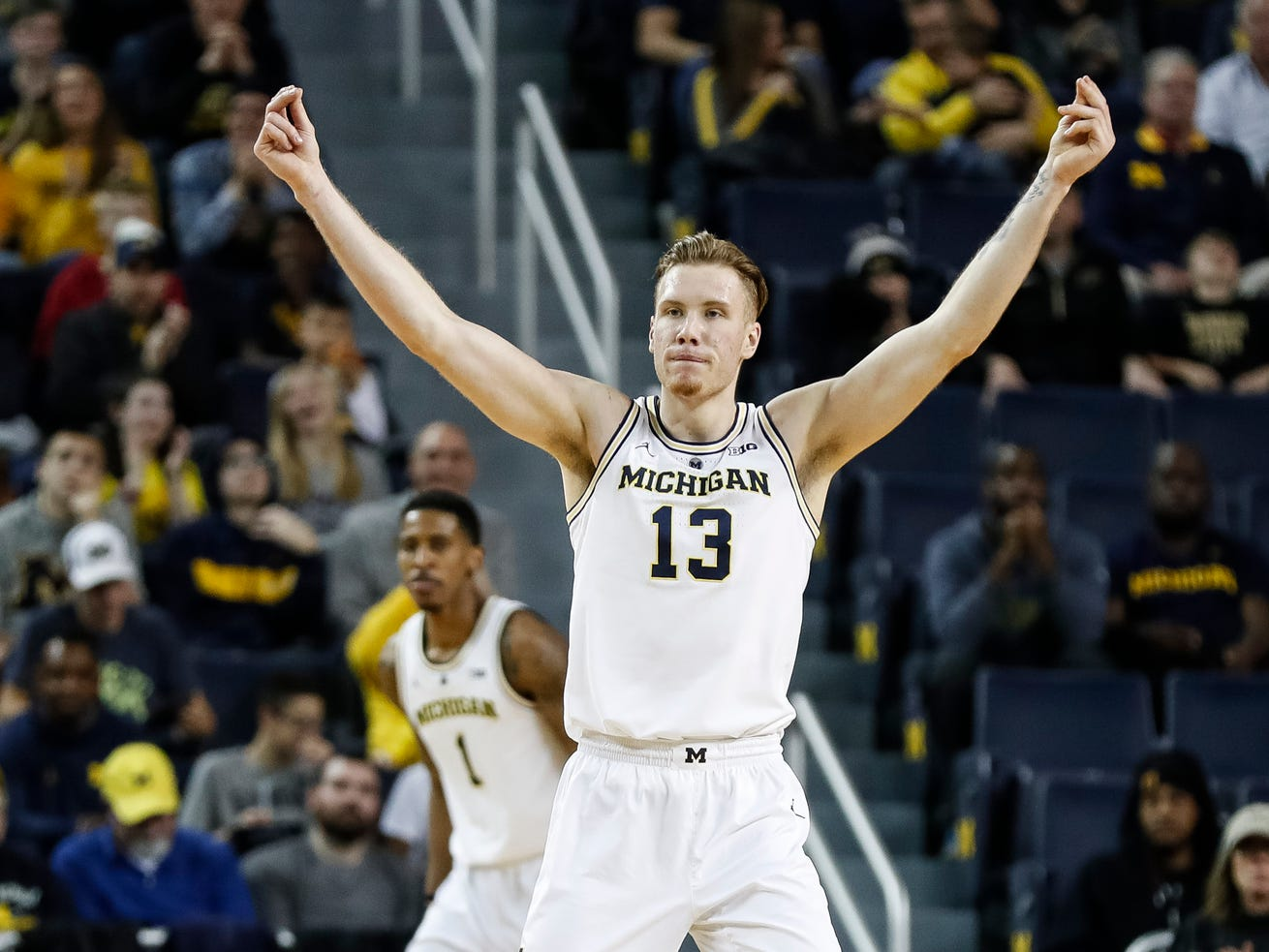 Michigan forward Ignas Brazdeikis (13) celebrates a 3-pointer during the first half against Purdue at Crisler Center on Saturday, Dec. 1, 2018.