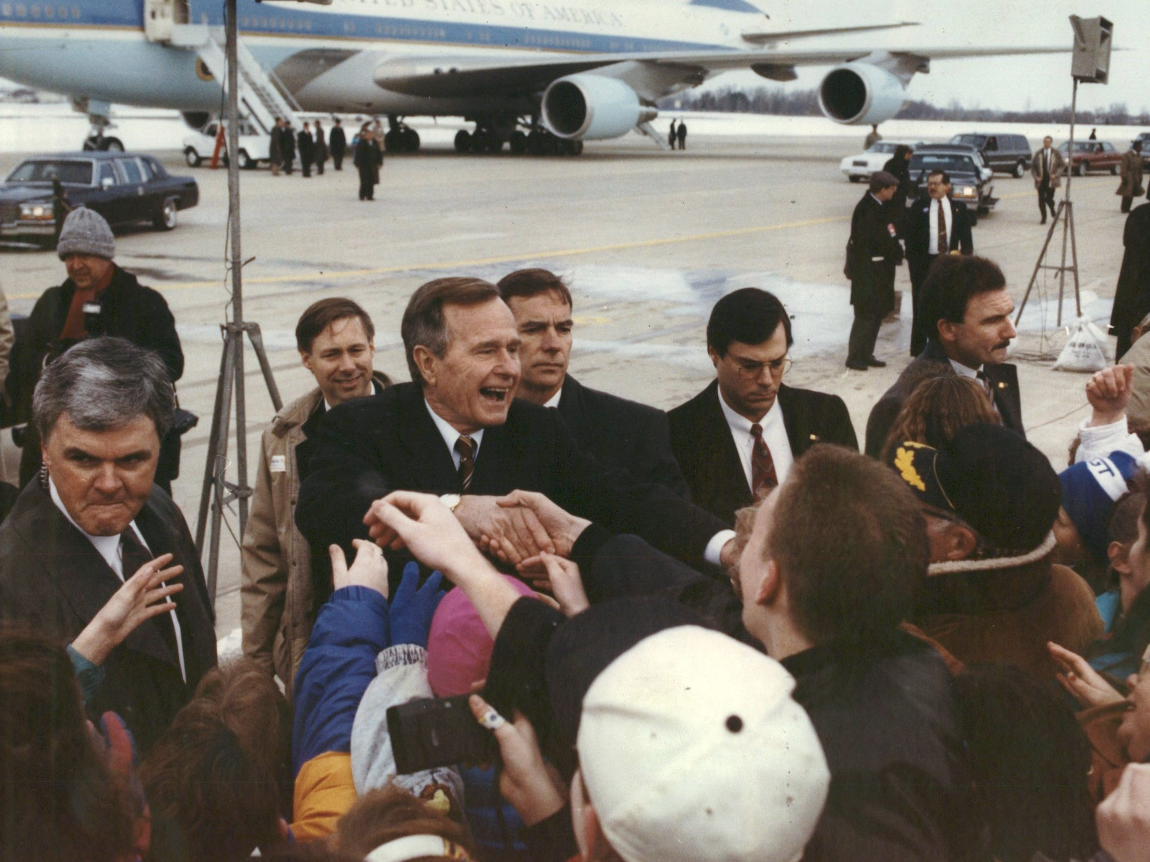 President George Bush shakes hands with supporters on his arrival in Battle Creek in March 1992.