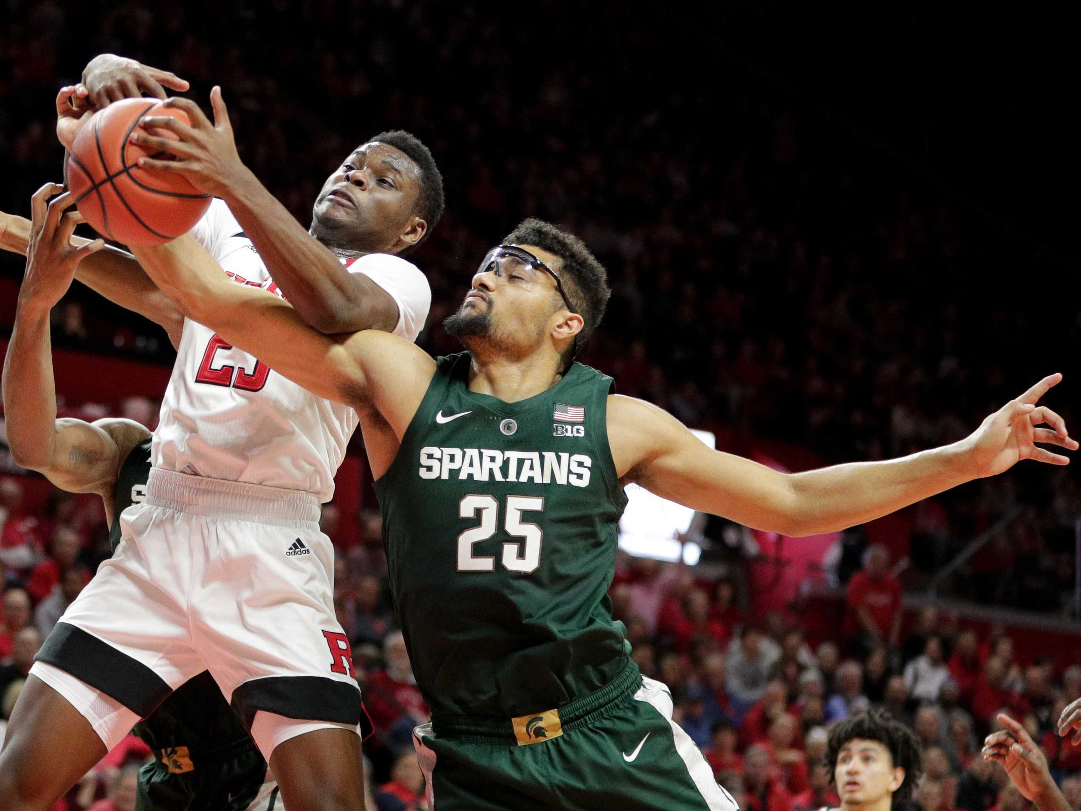 Rutgers guard Montez Mathis rebounds against Michigan State forward Kenny Goins during the second half at Rutgers Athletic Center on Nov. 30, 2018 in Piscataway, N.J.