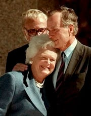 Former President George Bush hugs his wife, Barbara, after his address during the dedication of  the George Bush Presidential Library in College Station, Texas, Thursday, Nov. 6, 1997.