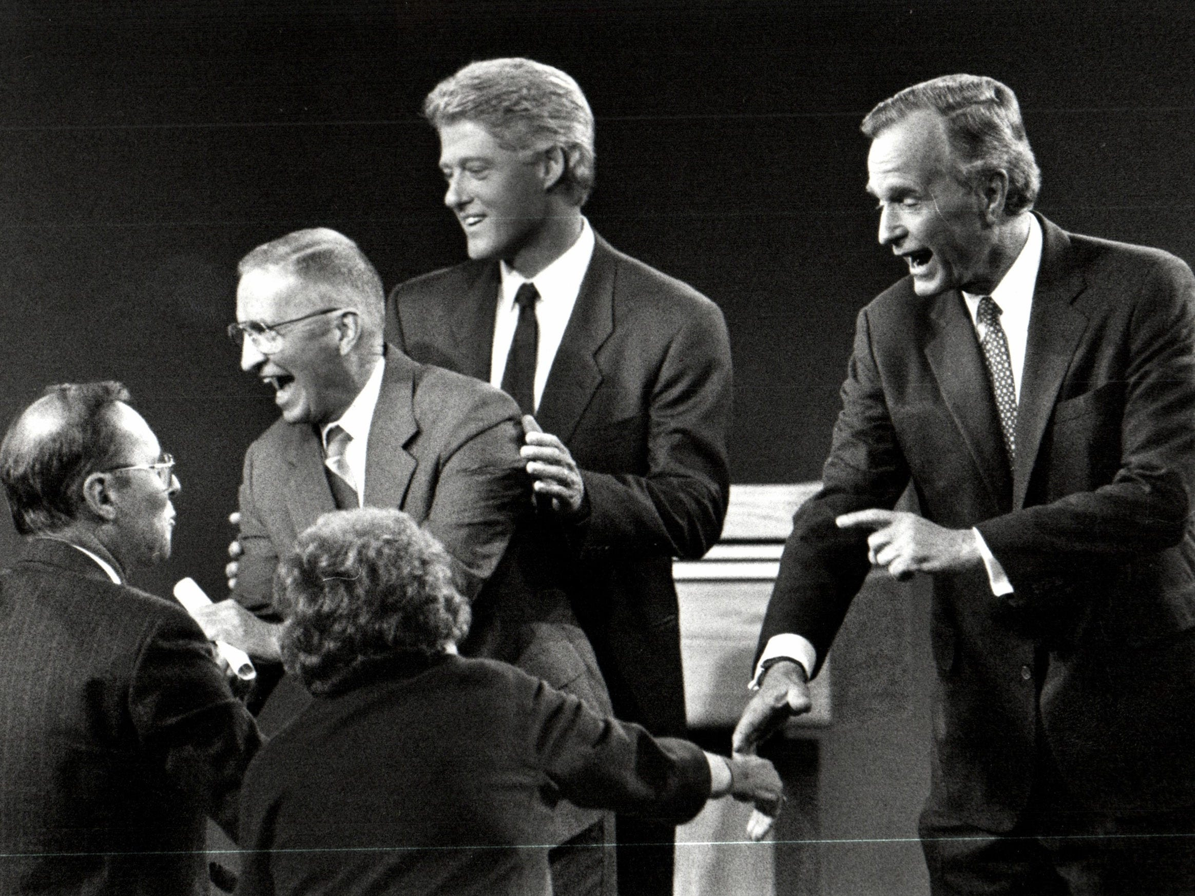 Ross Perot, Bill Clinton and George Bush greet questioners after the Presidential debate at Michigan State University in October 1992.