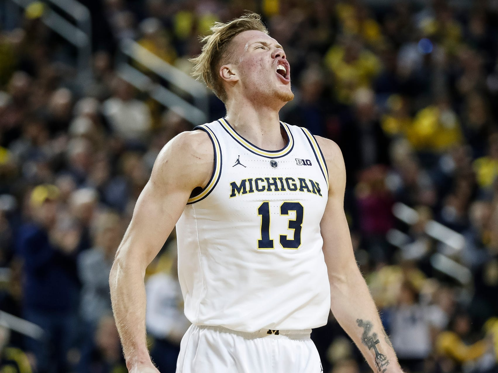 Michigan forward Ignas Brazdeikis (13) celebrates a dunk during the first half against Purdue at Crisler Center on Saturday, Dec. 1, 2018.