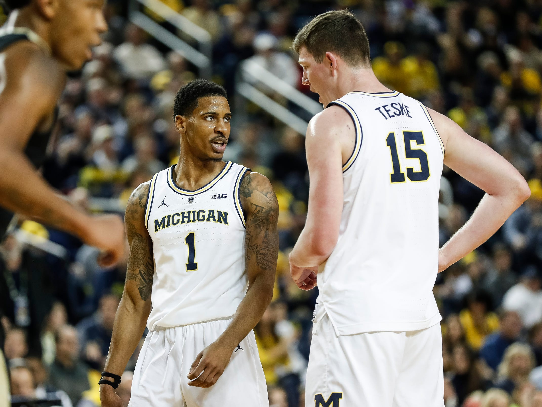 Michigan guard Charles Matthews (1) talks to center Jon Teske (15) during the first half against Purdue at Crisler Center on Saturday, Dec. 1, 2018.