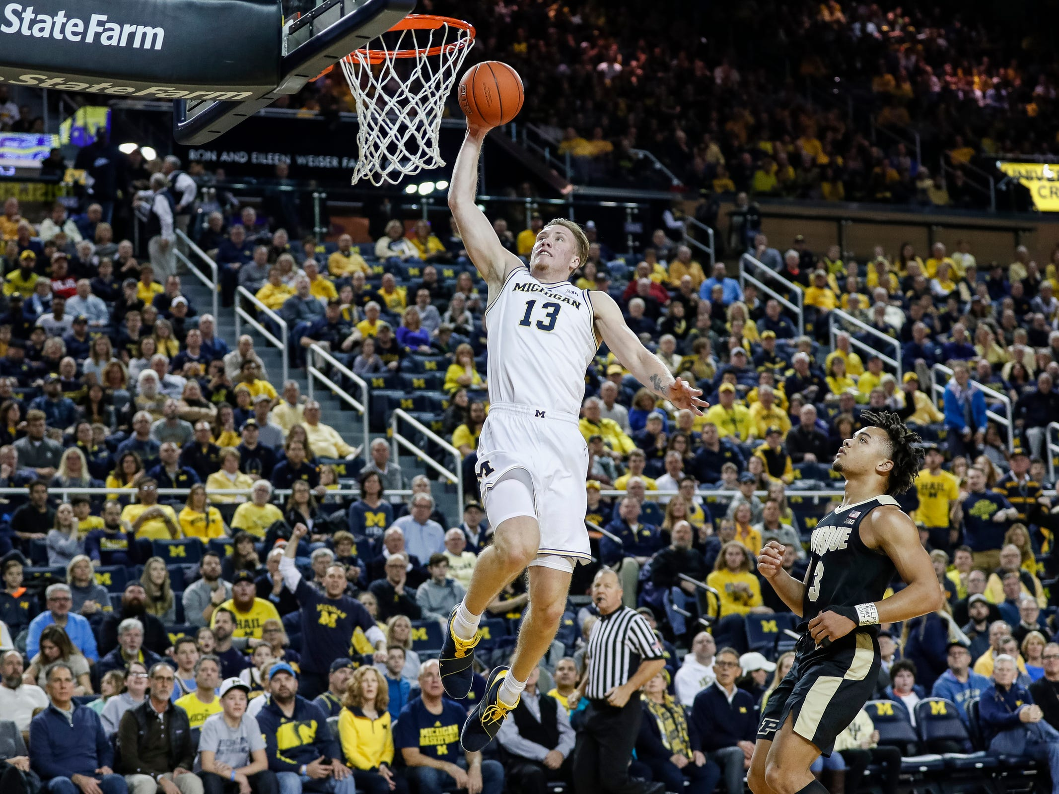 Michigan forward Ignas Brazdeikis (13) makes a dunk during the first half against Purdue at Crisler Center on Saturday, Dec. 1, 2018.