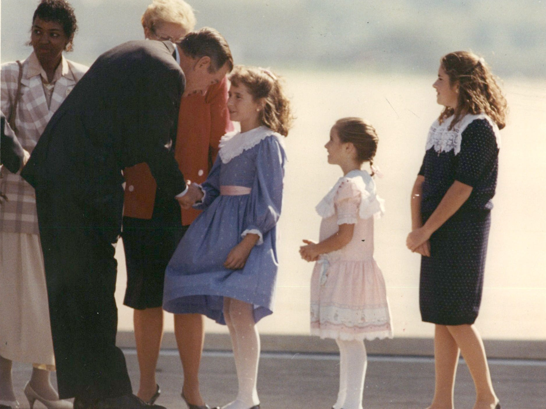 President George Bush visits Detroit and is greeted by Kerry Kerby at Selfridge Air National Guard Base  in September 1990.
