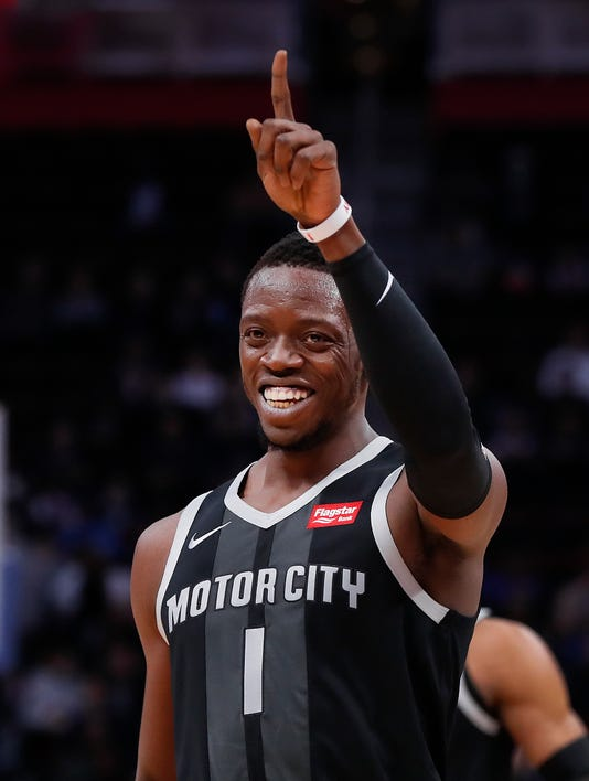 fa8c6556c Detroit Pistons guard Reggie Jackson reacts to a basket during the first  half. (Photo  Paul Sancya