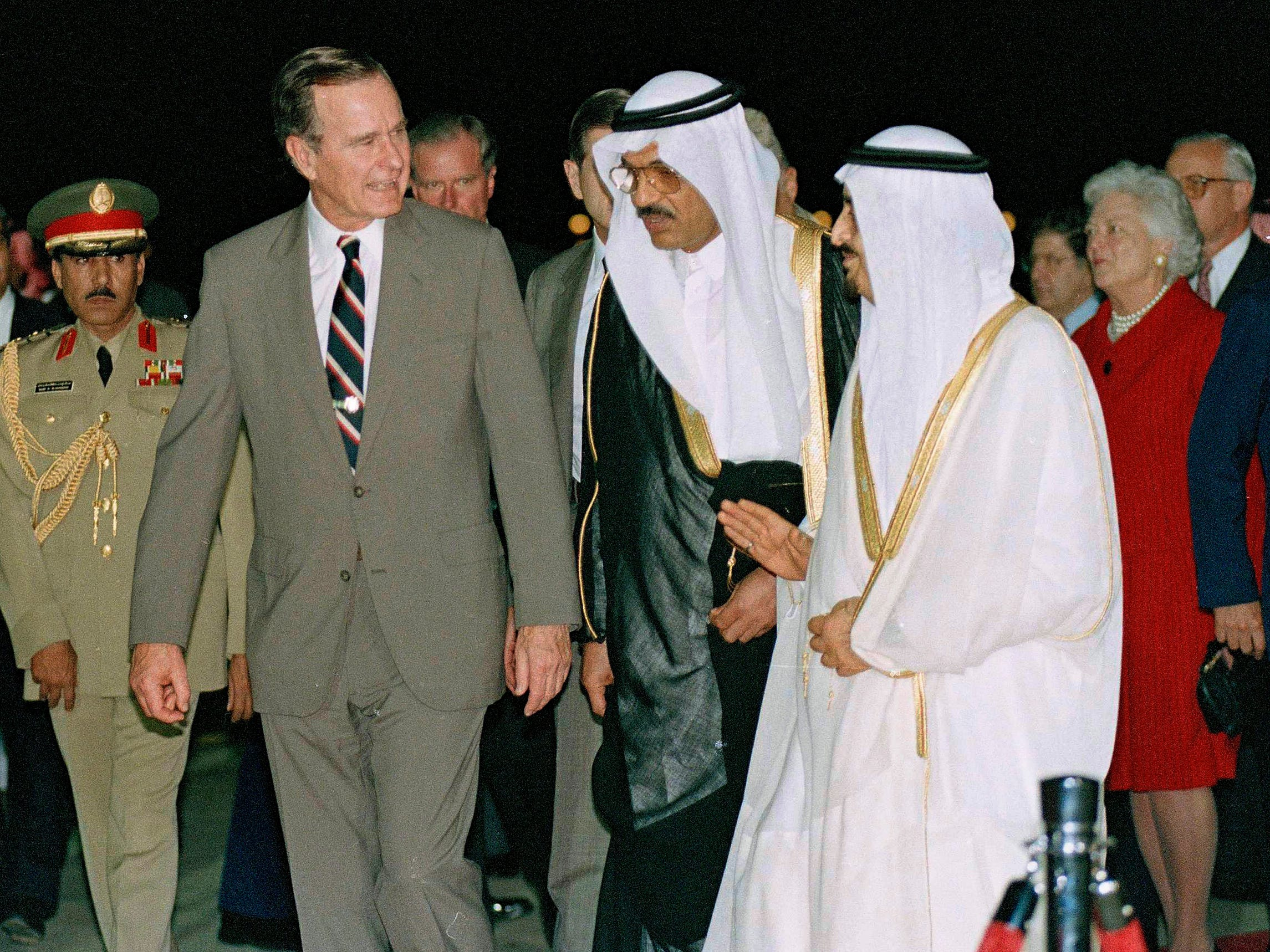 President George H.W. Bush is greeted by King Fahd on his arrival in Jeddah, Saudi Arabia on Nov. 21, 1990.