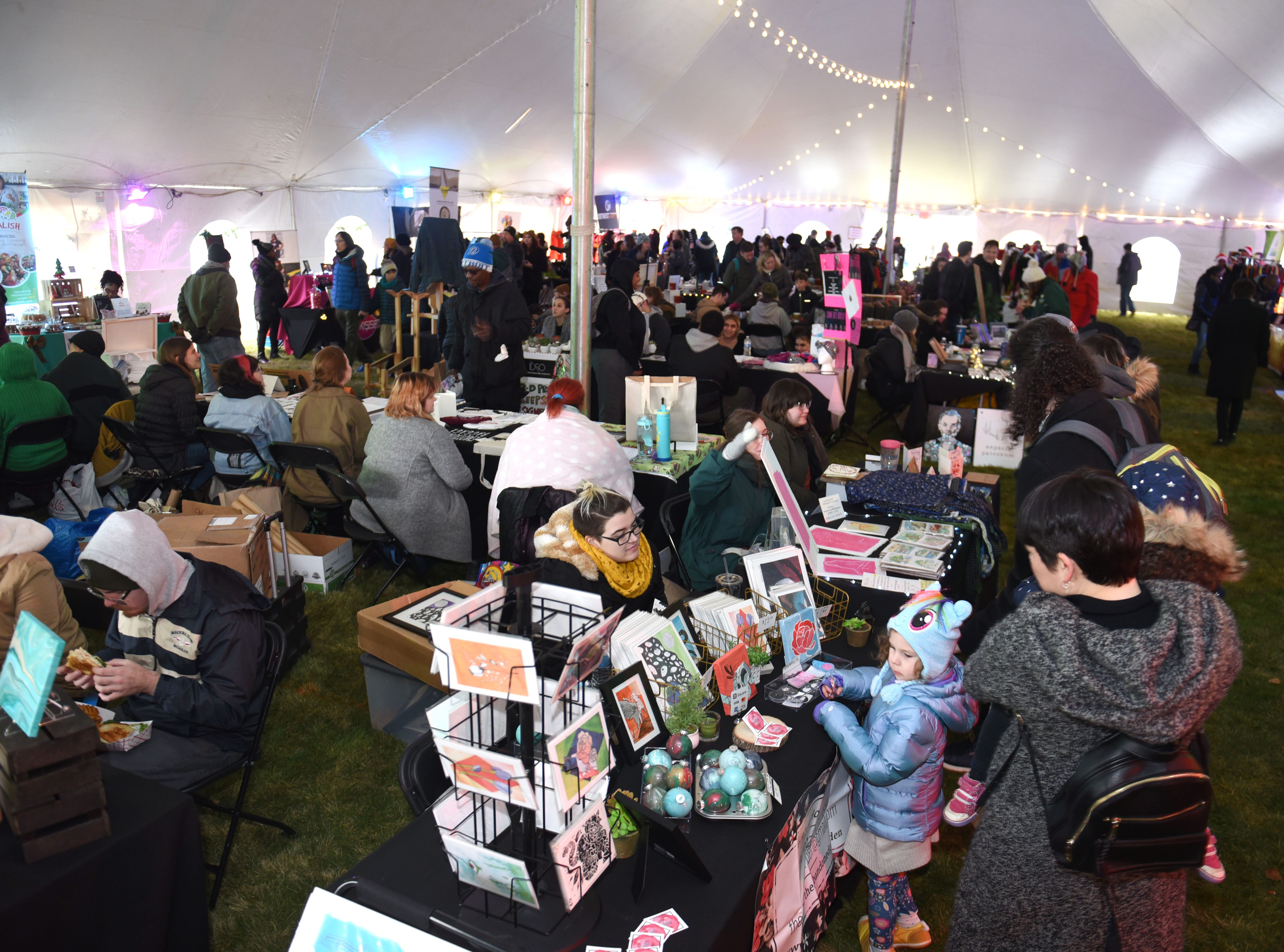 People fill the Winter Art and Retail Market  during Noel Night events in Detroit on Saturday, December 1, 2018.