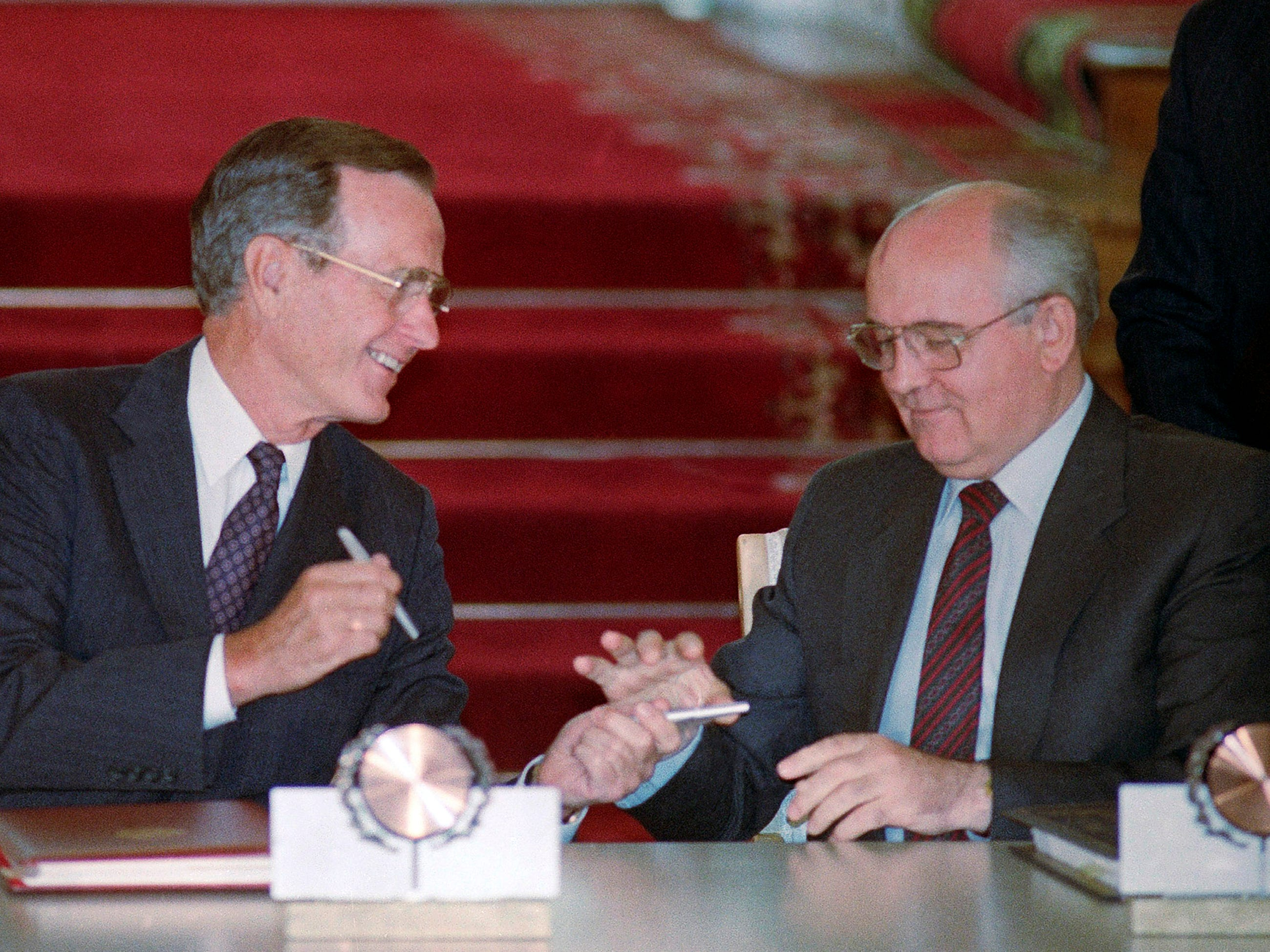 U.S. President George H. Bush and Soviet President Mikhail Gorbachev exchange pens after signing the START arms reduction treaty in the Kremli in Moscow on Aug. 1, 1991.