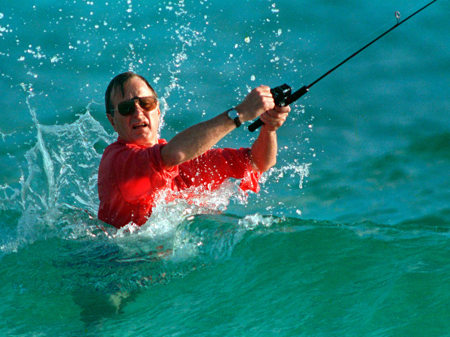 President-elect George H.W. Bush as he casts a line while fishing in Gulf Stream, Fla. on Nov. 12, 1988.
