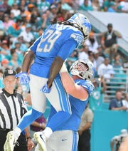 After a four-game slump, Lions running back LeGarrette Blount (29), shown here against the Dolphins, responded on Thanksgiving with 88 yards and two touchdowns against the Chicago Bears.