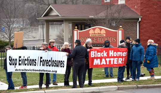 More than 25 residents and supporters of Brightmoor Homes protest before posting their computer-aided eviction notices.