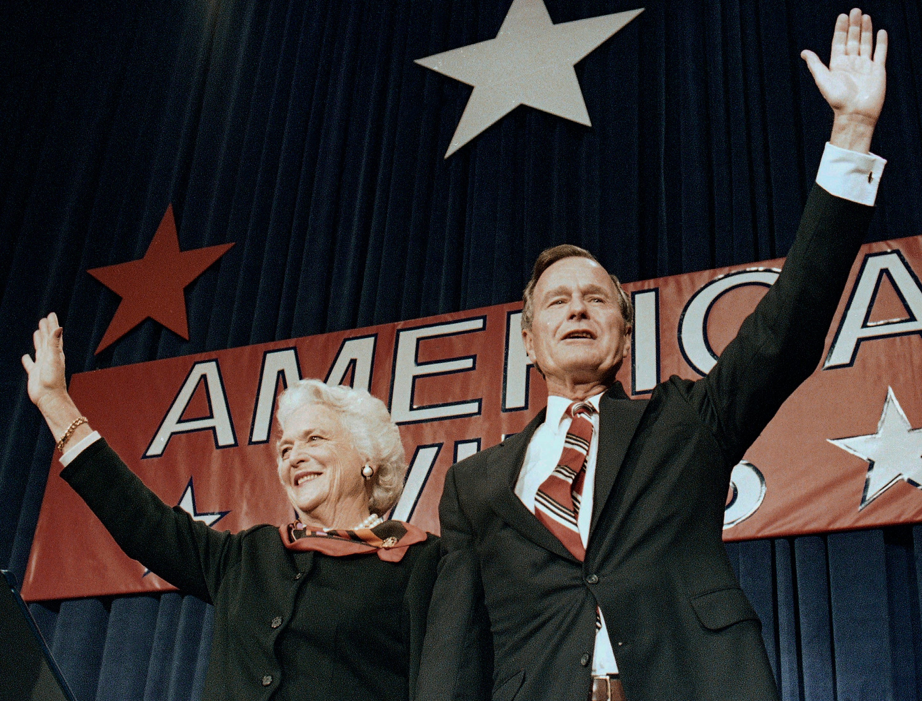 On Nov. 8, 1988, President-elect George H.W. Bush and his wife Barbara wave to supporters in Houston, Texas after winning the presidential election.