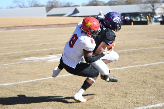 Ferris State defensive back DeShaun Thrower makes a tackle.