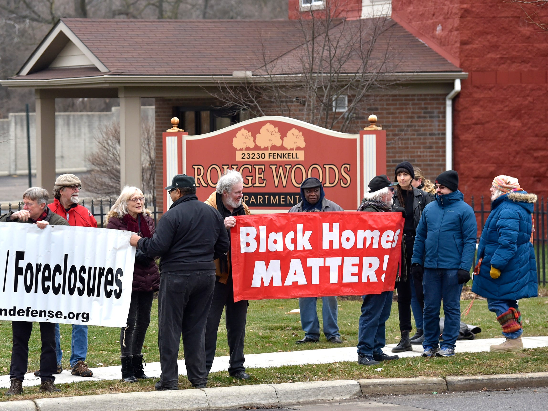 "More than 25 residents and supporters of Brightmoor Homes protest before posting their ""eviction notices"" at the KMG Prestige Management Company office inside the Rouge Woods Apartments complex."