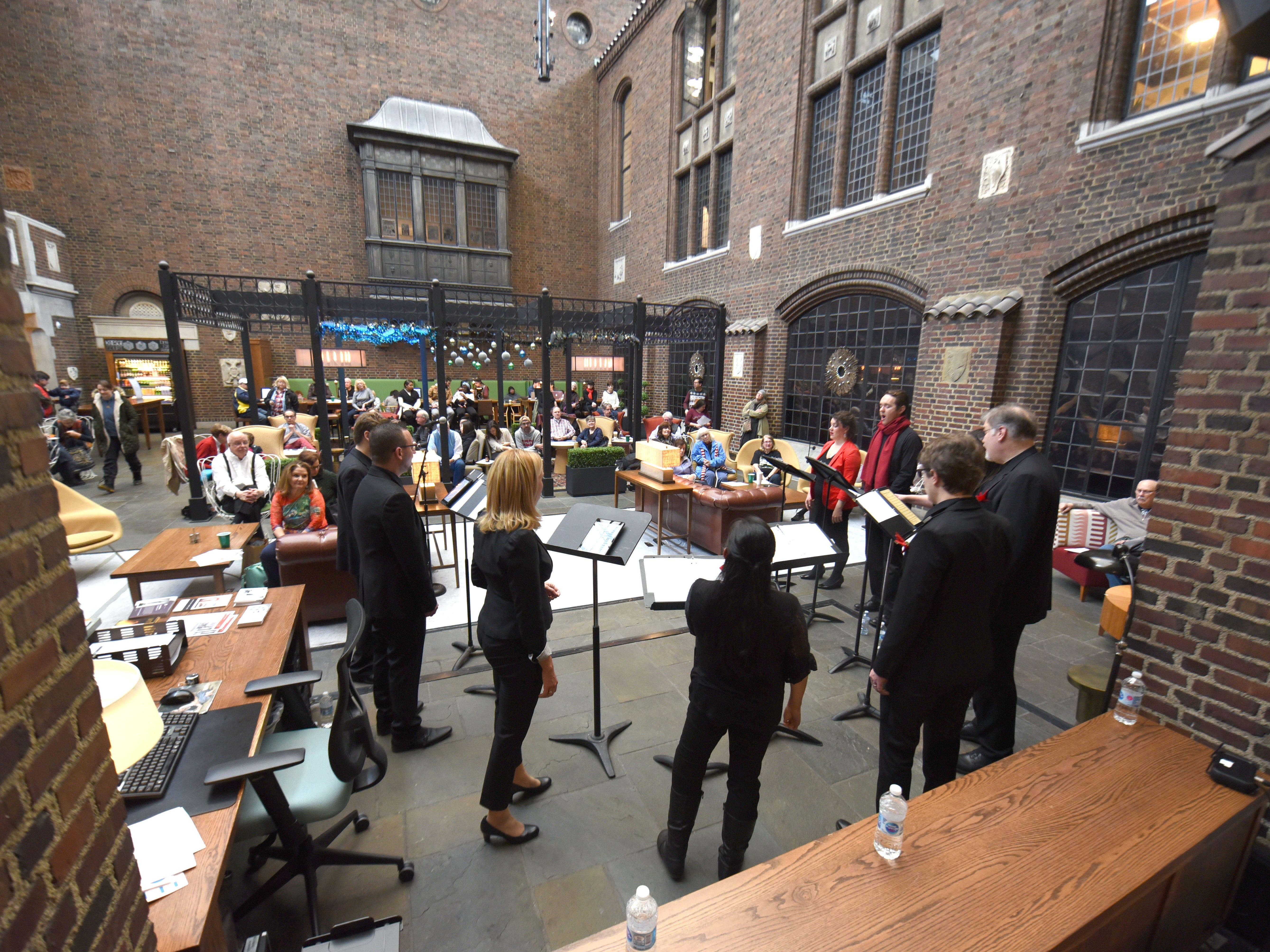 The vocal ensemble Audivi perform at Kresge Court inside the Detroit Institute of Art during Noel Night in Detroit on Saturday, December 1, 2018.