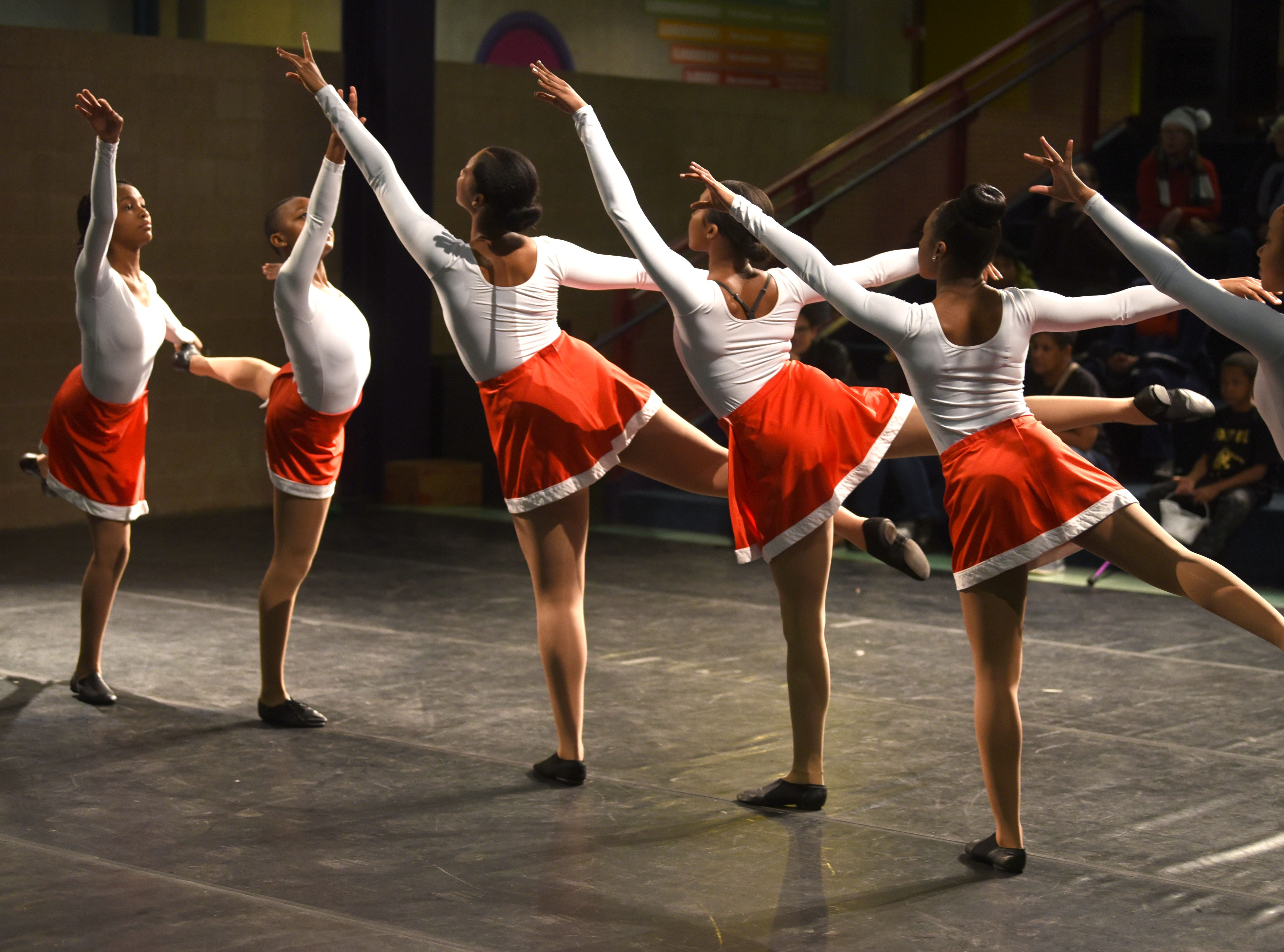 Members of the Marygrove Institute Repertory dancers perform at the Michigan Science Center during Noel Night.