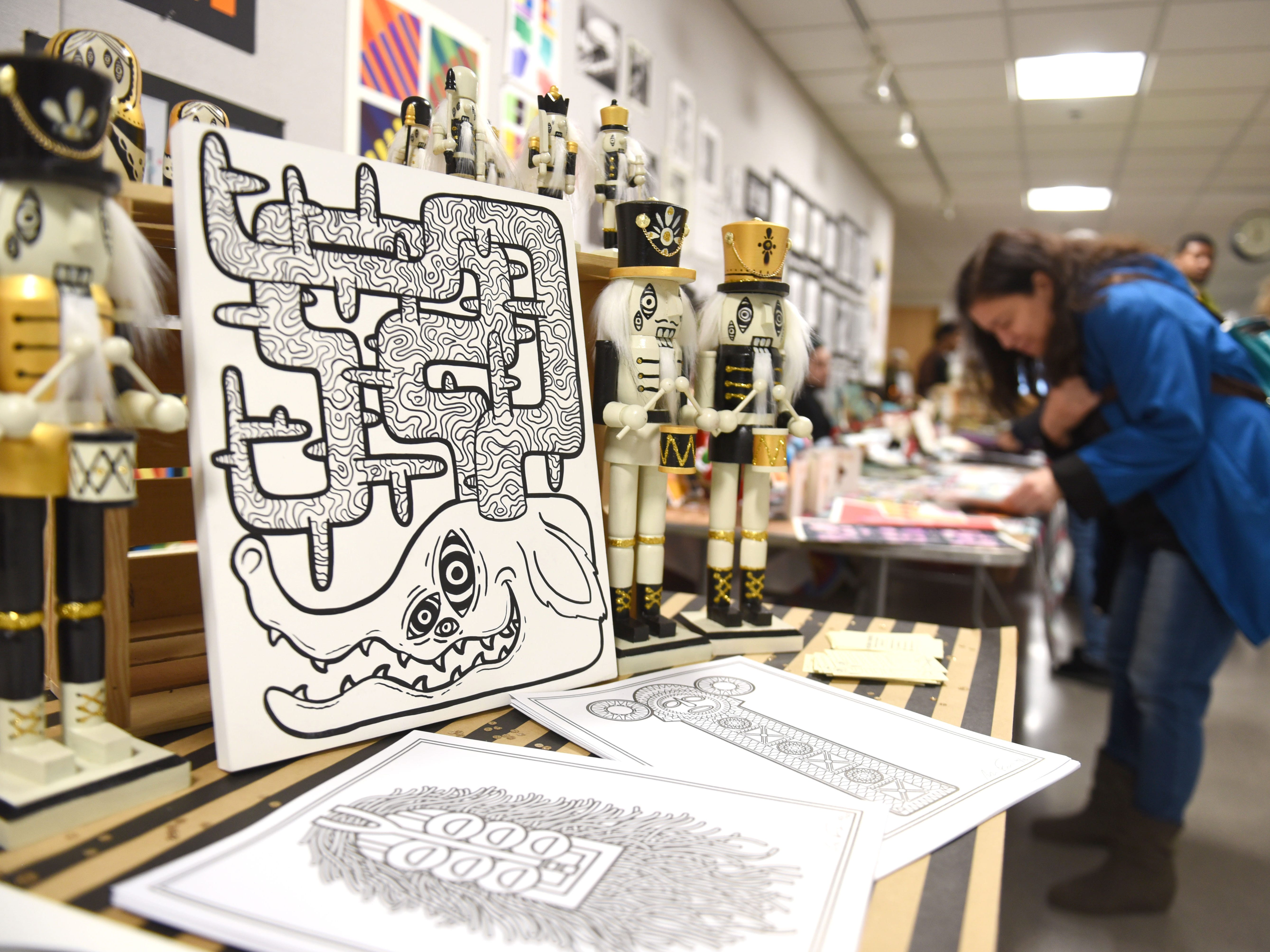 The hand drawn artwork (left) of CCS student Melanie Formica is displayed during the Annual Student Alumni Art Sale at the College of Creative Studies during Noel Night.