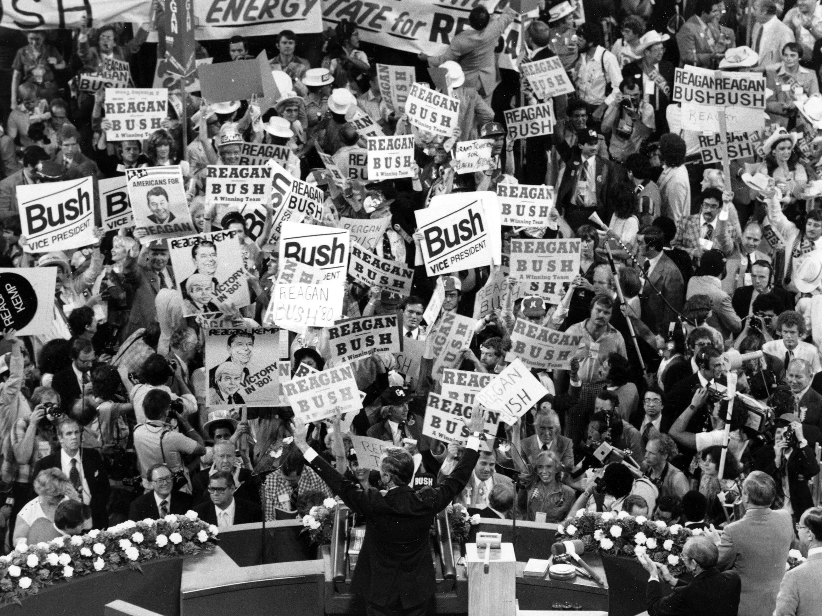 At the Republican Convention in Detroit on July 16, 1980, George H.W. Bush, center foreground, acknowledges the crowd before speaking to the delegates.
