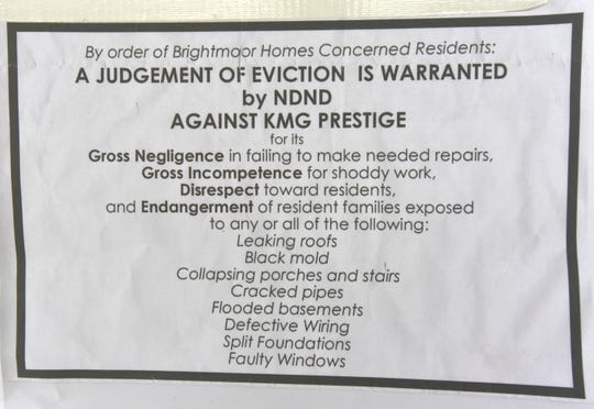 One of the Brightmoor Homes Concerned Residents eviction notices posted on the front door of the KMG Prestige Management Company offices.