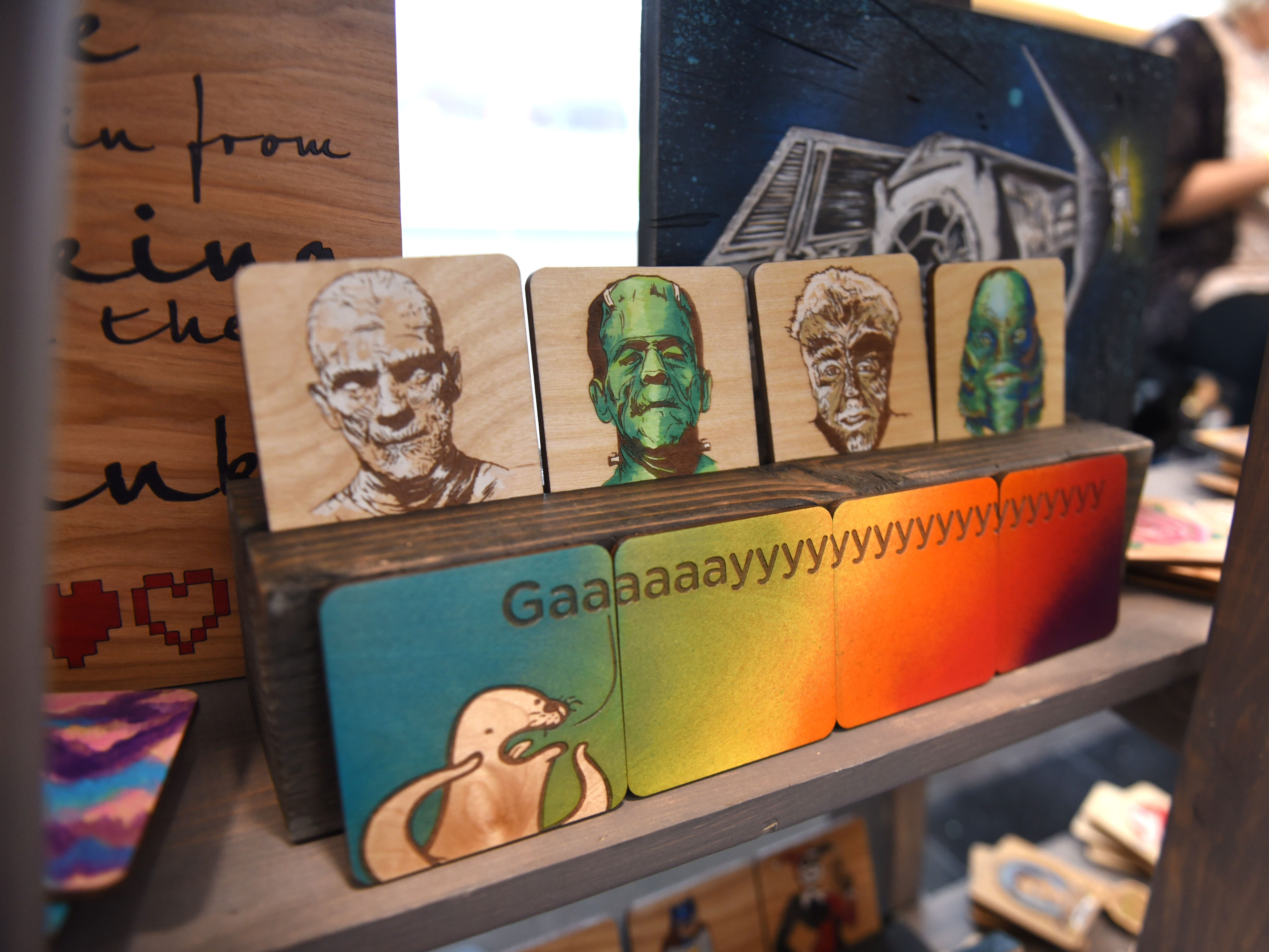 The laser engraved and hand painted coasters by artist Jessica Rowland
