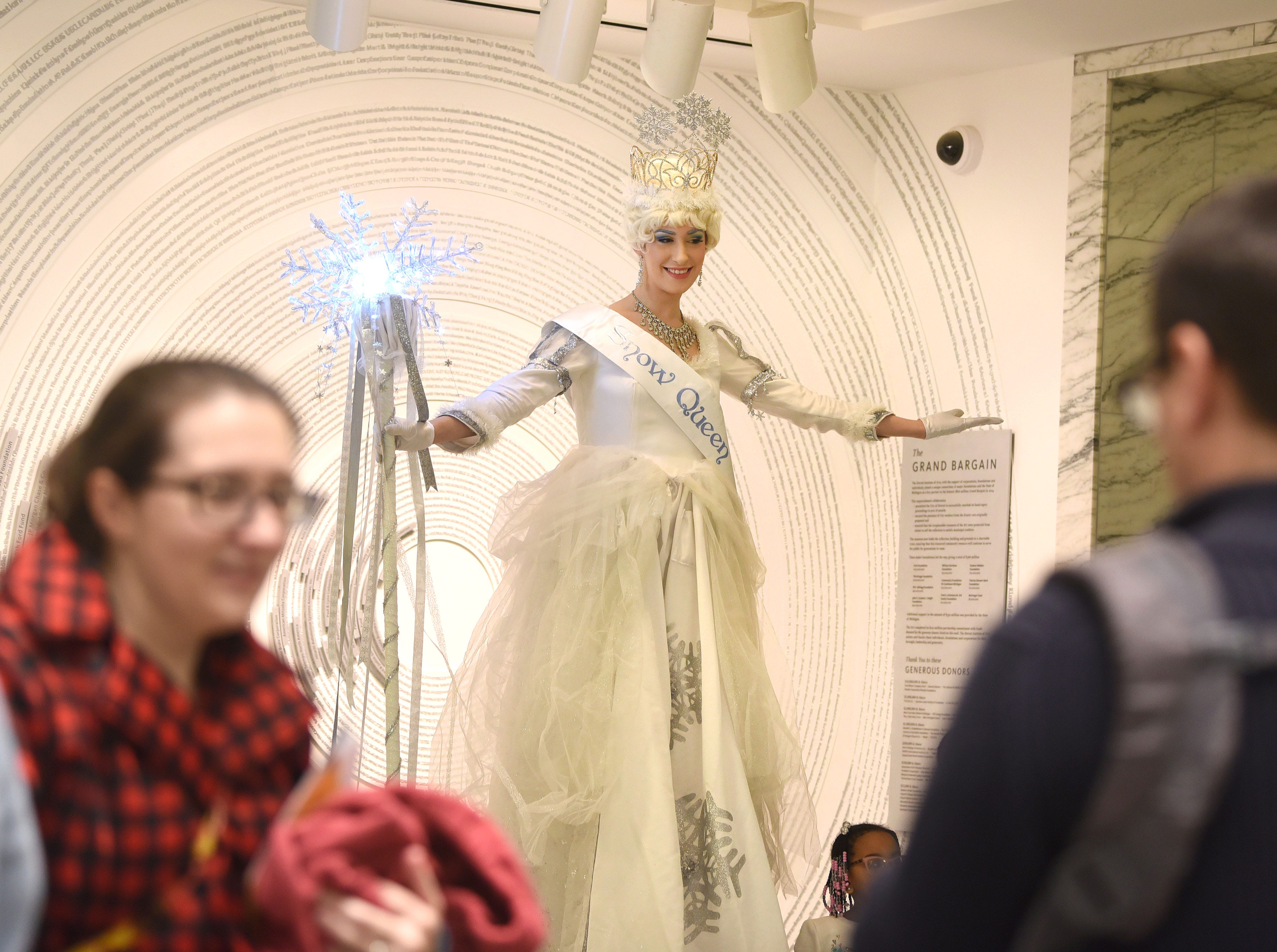 The Snow Queen poses for photographs in Prentis Court at the Detroit Institute of Art during Noel Night in Detroit on Saturday, December 1, 2018.