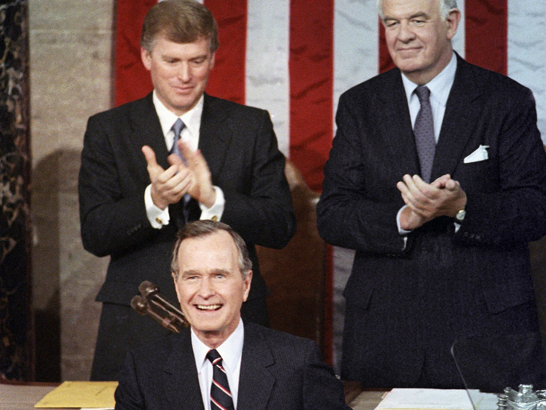President George H.W. Bush receives applause from Vice President Dan Quayle, left, and House Speaker Thomas Foley prior to delivering his first State of the Union address on Capitol Hill on Jan. 31, 1990.
