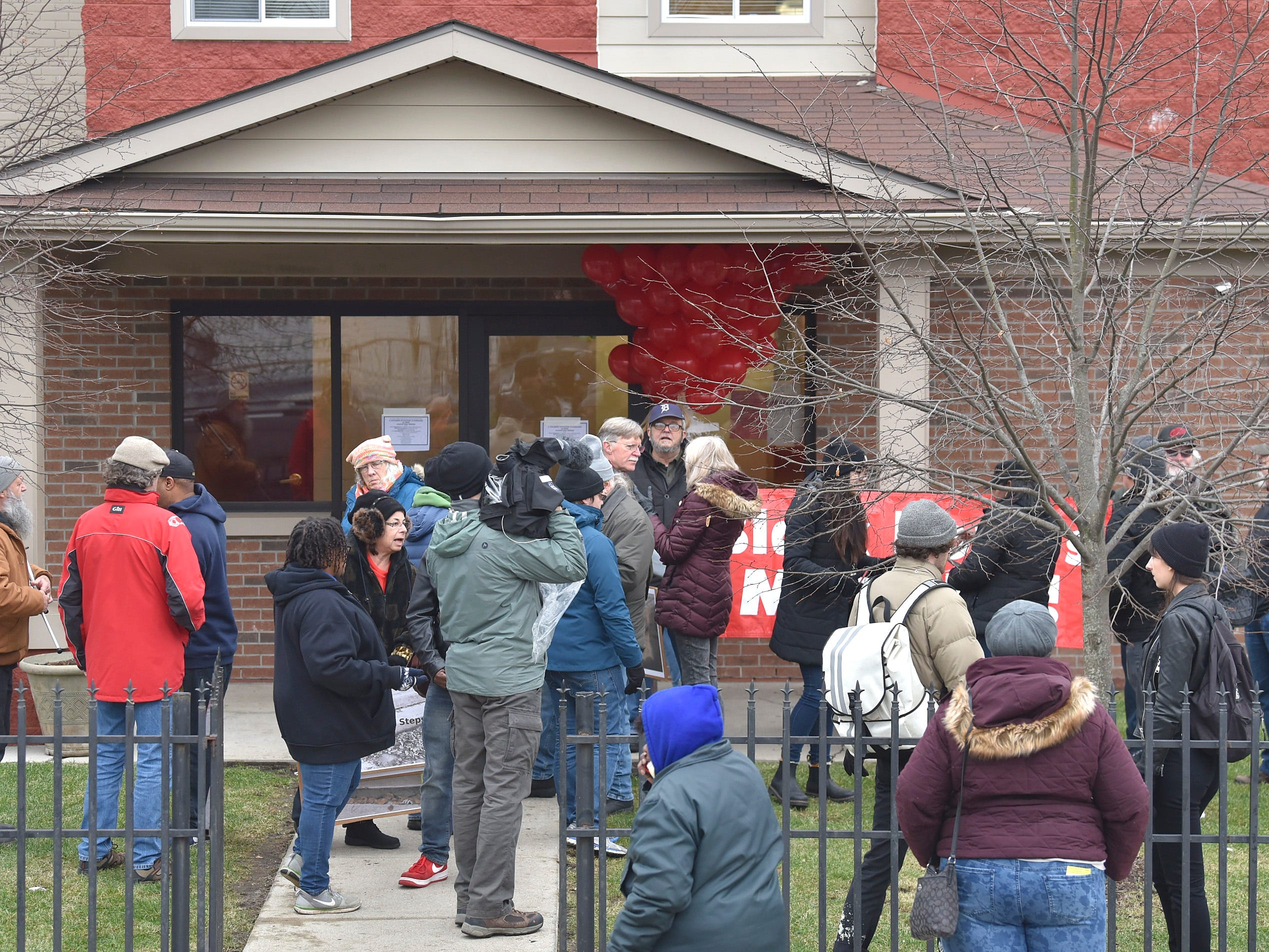 More than 25 residents and supporters of Brightmoor Homes post eviction notices for the KMG Prestige Management Company at their offices inside the Rouge Woods Apartments complex, on Fenkell at Hazelton, Saturday morning.