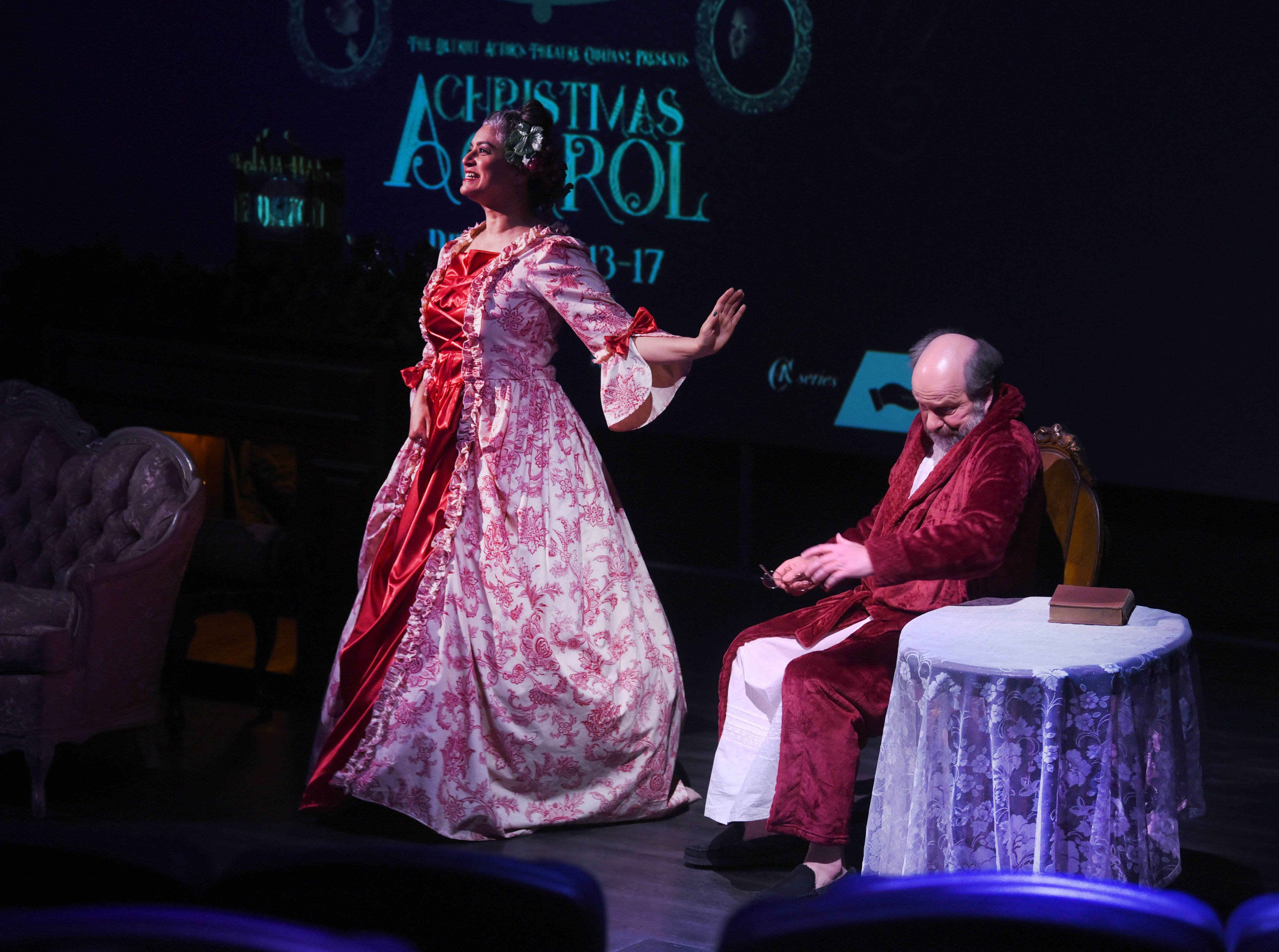 Actors perform a scene from A Christmas Carol at the Michigan Science Center during Noel Night in Detroit on Saturday, December 1, 2018. The production of A Christmas Carol will debut at the Jam Handy Theater in Detroit from December 13-17, 2018