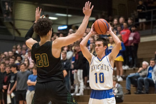 Castle's Conner Lockyear (10) looks for an open teammate against Floyd Central. The senior missed three months during basketball with two herniated discs in his back.