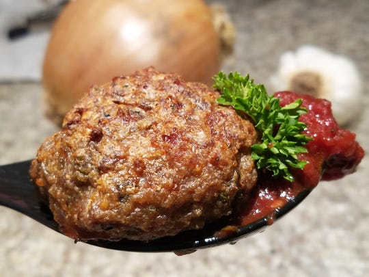 Albondigas are Spanish meatballs with unexpected flavors and a rich red wine sauce.