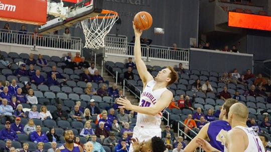 Evansville sophomore Noah Frederking finishes at the rim Saturday afternoon against Albion. The Aces won, 65-49.