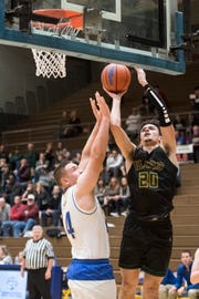 Floyd Central's Cobie Barnes (20) poured in 32 points in the Highlanders' romp over Castle, joining the school's 1,000-point club. He has signed with Indiana State.