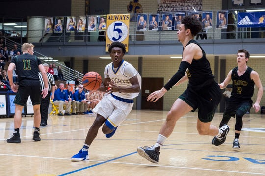 Castle's Isaiah Swope (4) drives the ball to the basket during the Castle vs Floyd Central basketball game at Castle High School Friday, Nov. 30, 2018.