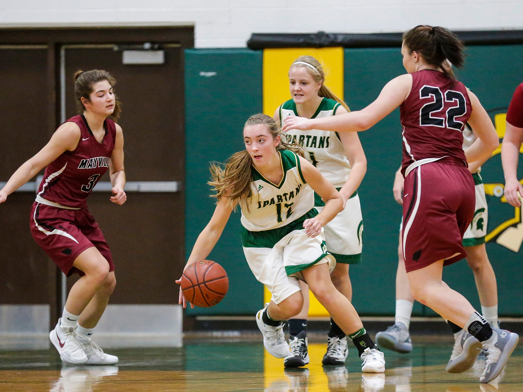Laconia High School girls basketball's Lexy Smit breaks away with the ball against Mayville High School during their game Friday, November 30, 2018 in Rosendale. Doug Raflik/USA TODAY NETWORK-Wisconsin