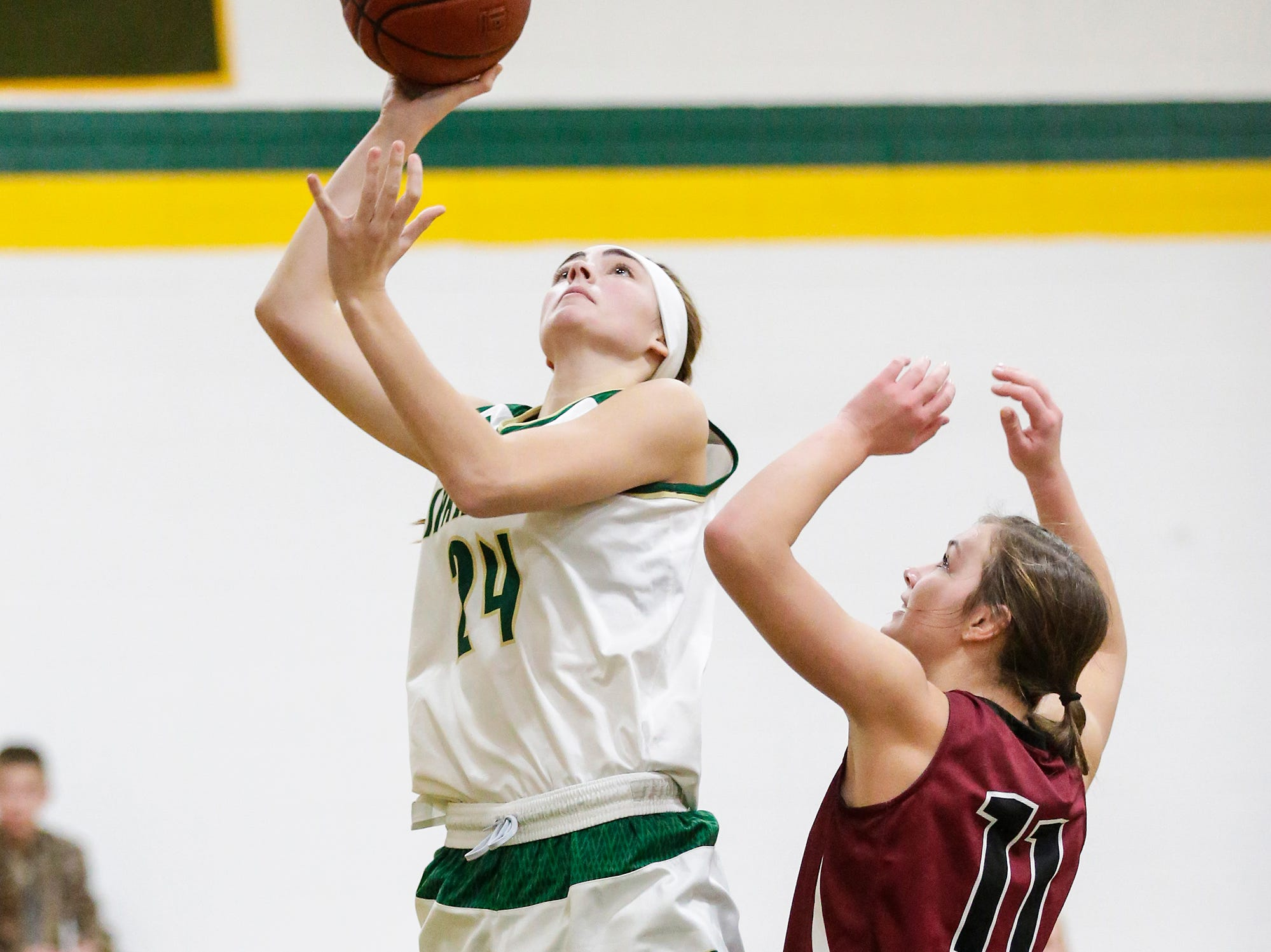 Laconia High School girls basketball's Maci Grade goes up for a basket over Mayville High School's Whitney Liegl during their game Friday, November 30, 2018 in Rosendale. Doug Raflik/USA TODAY NETWORK-Wisconsin