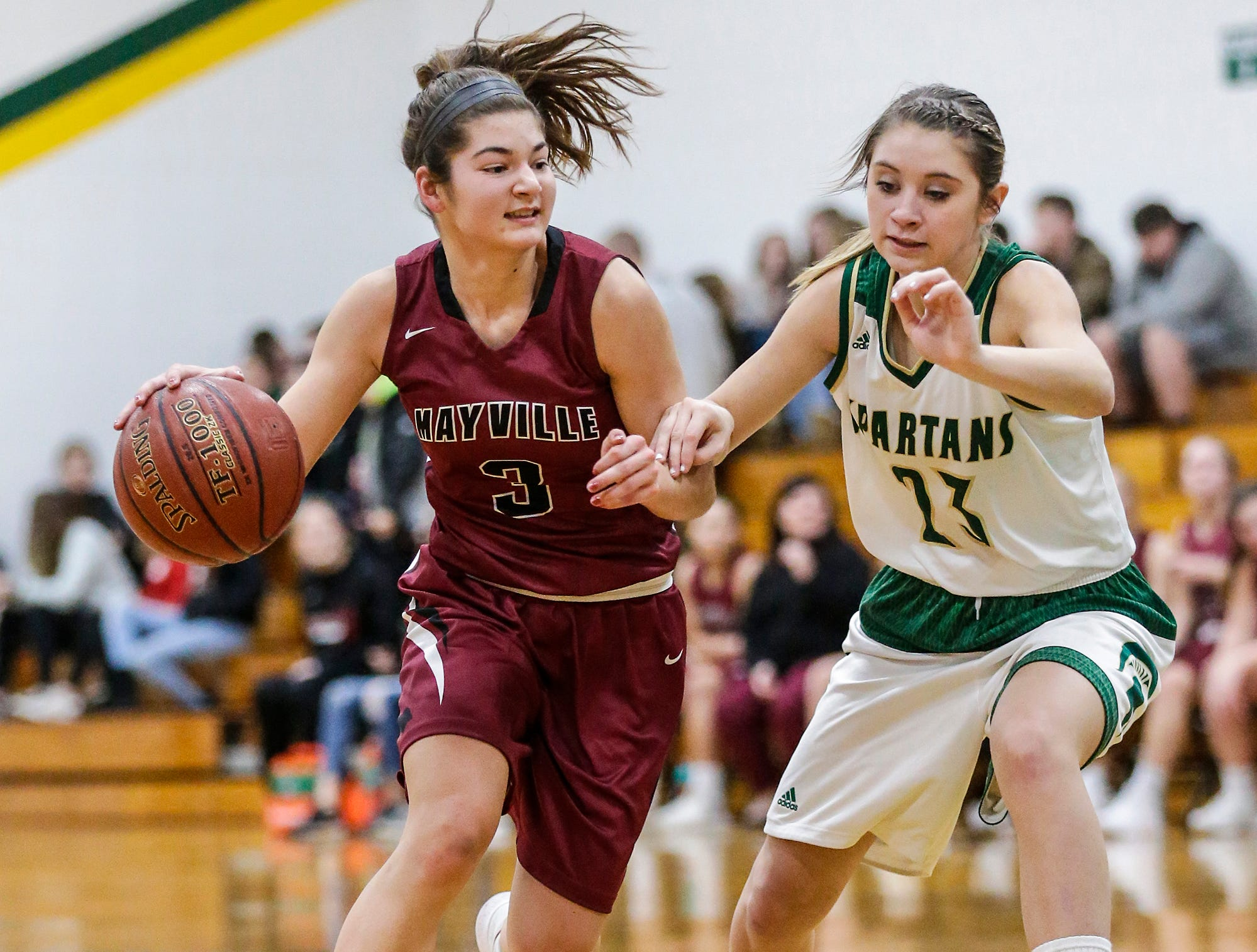 Mayville High School girls basketball's Amber Schraufnagel works her way down the court while being defended by Laconia High School's Harper Wurtz during their game Friday, November 30, 2018 in Rosendale. Doug Raflik/USA TODAY NETWORK-Wisconsin