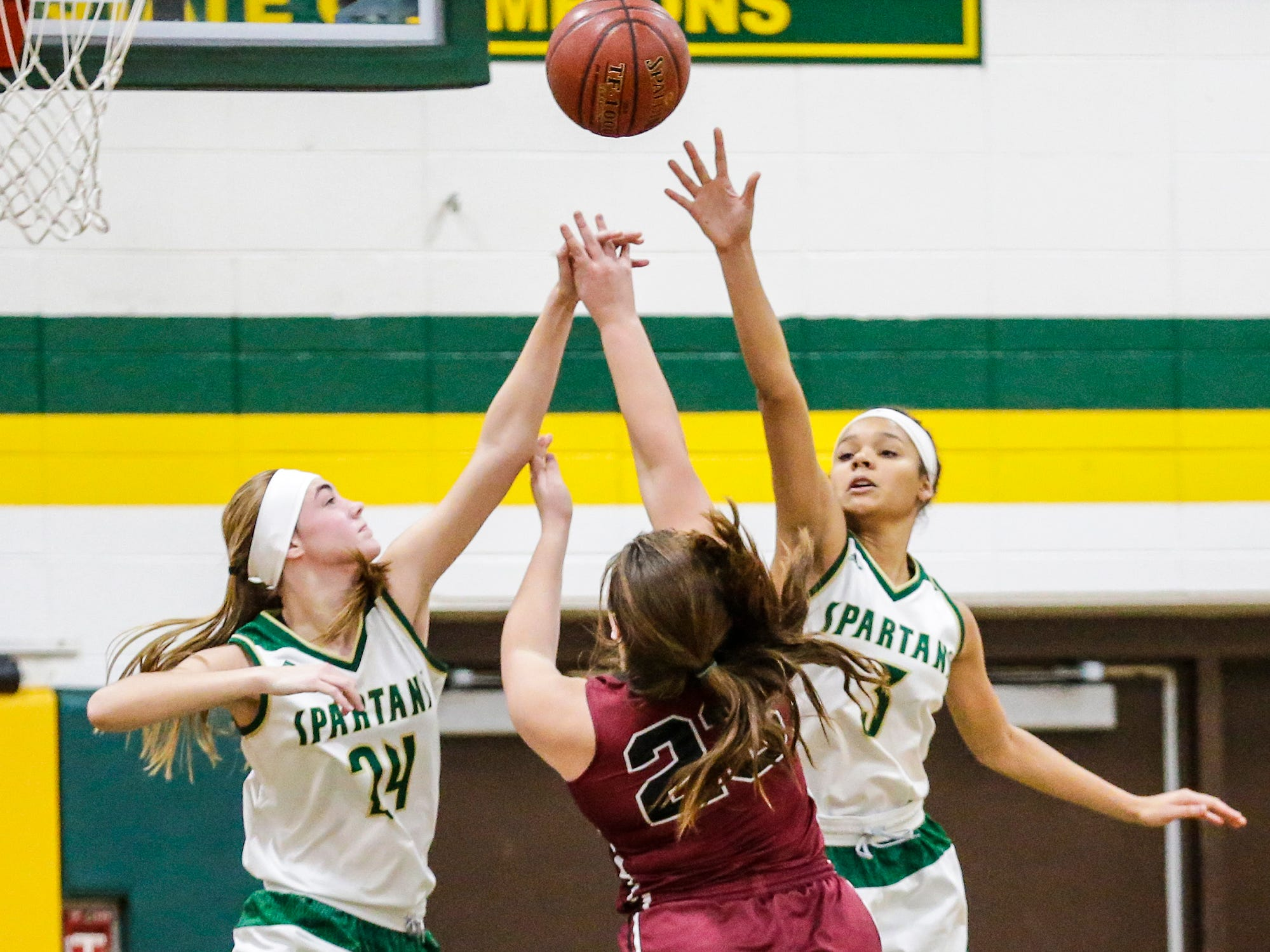 Laconia High School girls basketball's Maci Grade (24) and Kiarra Otto (3) attempt to block a shot by Mayville High School's Makenzie Perry during their game Friday, November 30, 2018 in Rosendale. Doug Raflik/USA TODAY NETWORK-Wisconsin