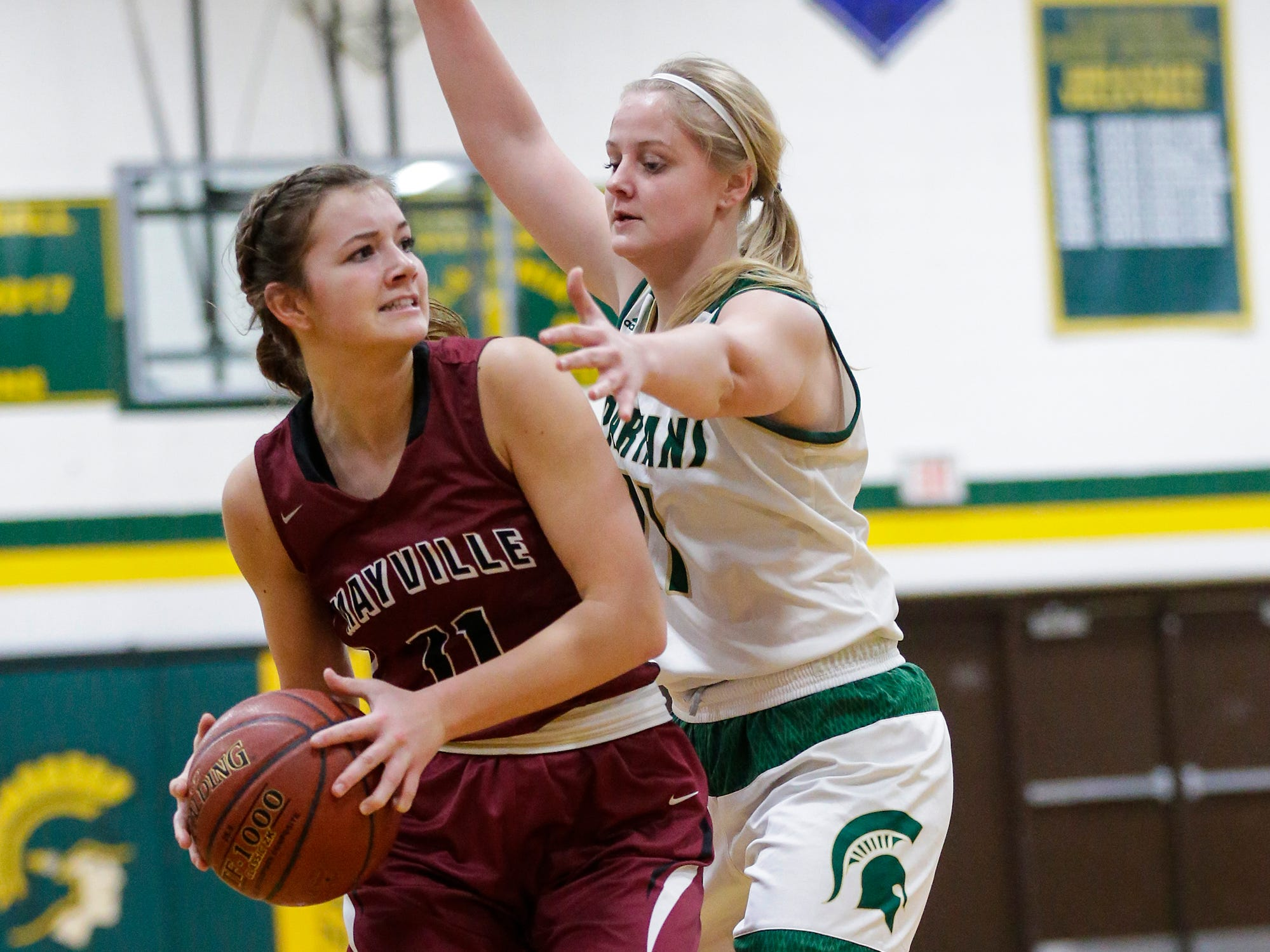 Mayville High School girls basketball's Whitney Liegl tries to pass the ball away from Laconia High School's Faith Weed during their game Friday, November 30, 2018 in Rosendale. Doug Raflik/USA TODAY NETWORK-Wisconsin