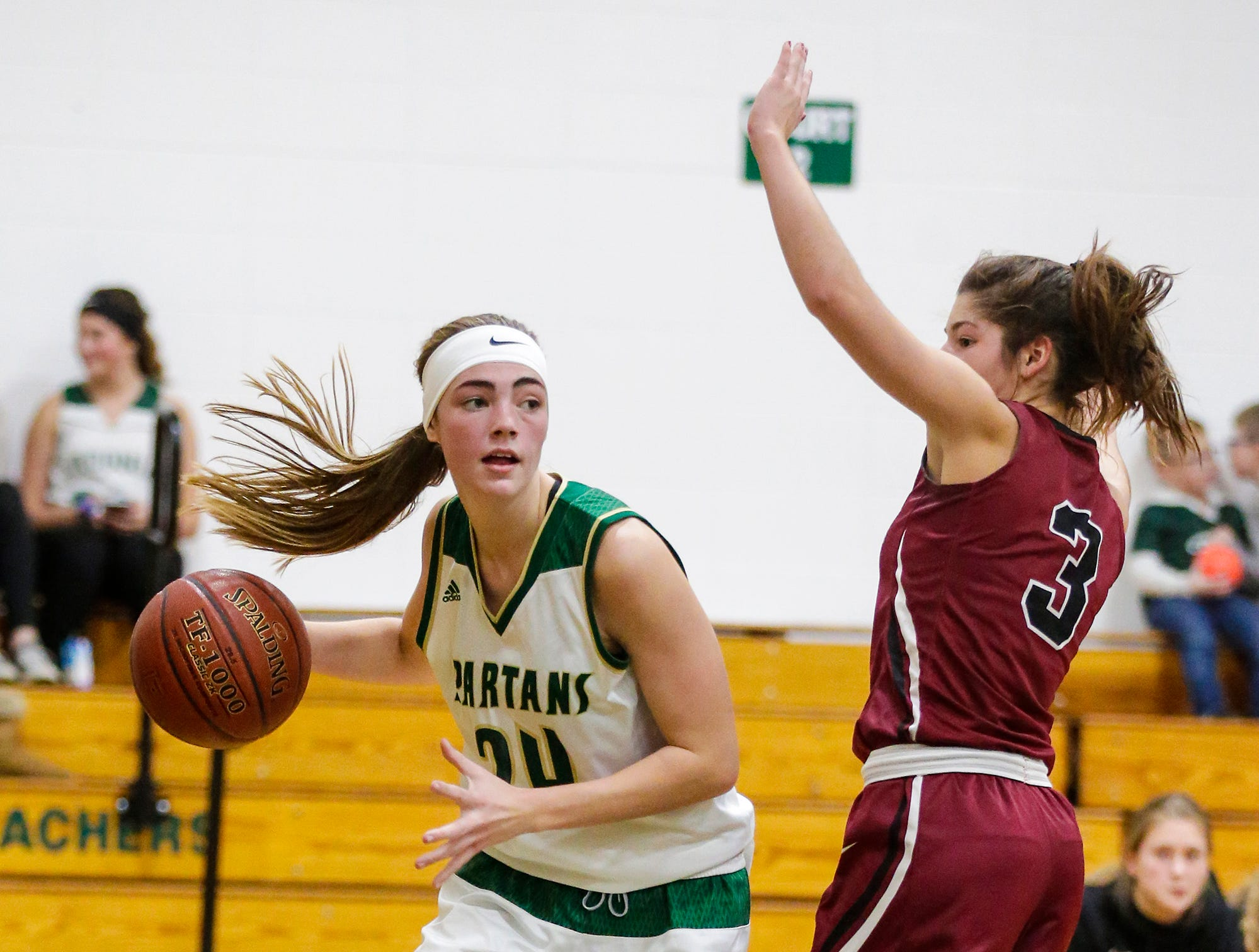 Laconia High School girls basketball's Maci Grade attempts to get by Mayville High School's Amber Schraufnagel during their game Friday, November 30, 2018 in Rosendale. Doug Raflik/USA TODAY NETWORK-Wisconsin