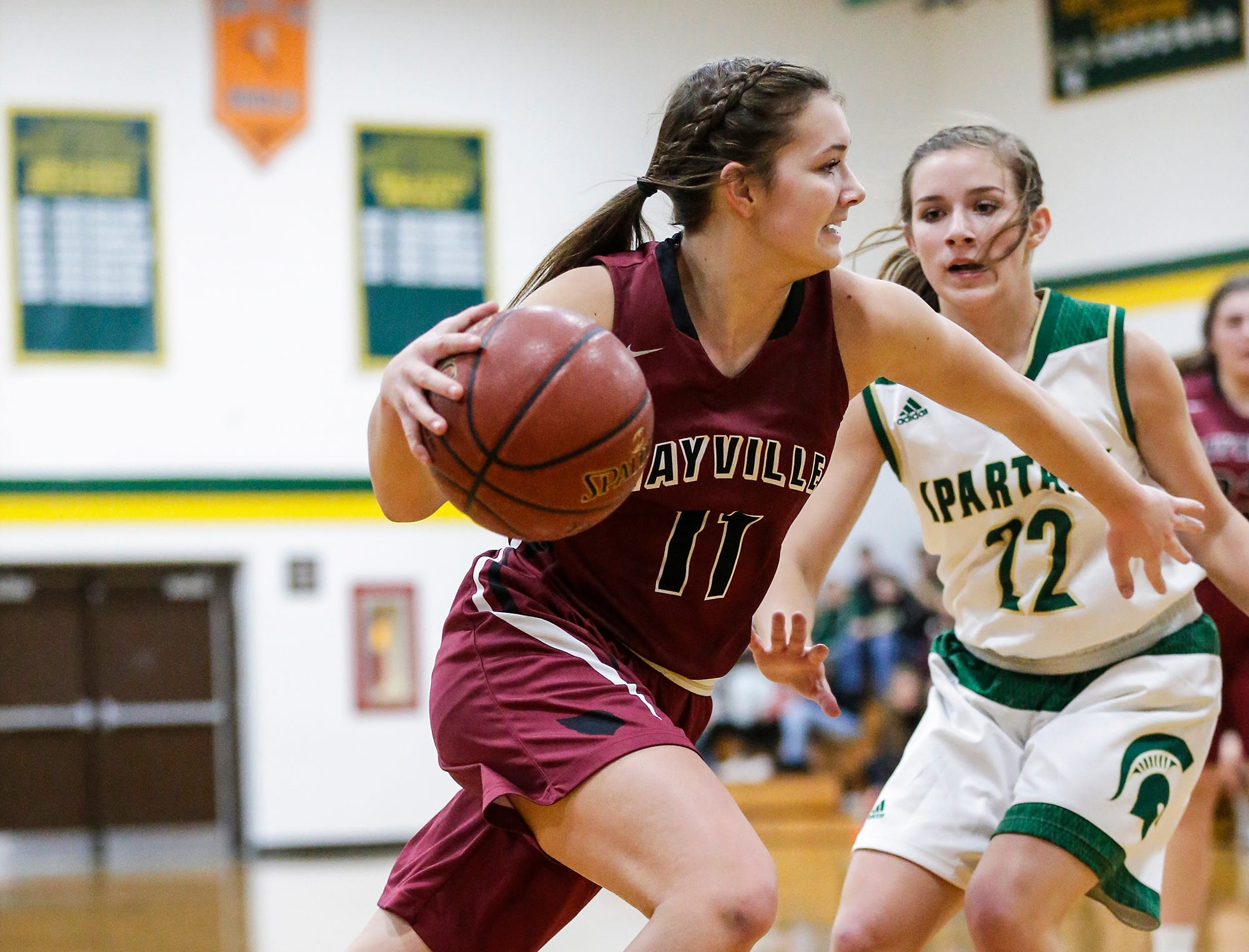 Mayville High School girls basketball's Whitney Liegl breaks towards the basket past Laconia High School's Haley Rens during their game Friday, November 30, 2018 in Rosendale. Doug Raflik/USA TODAY NETWORK-Wisconsin