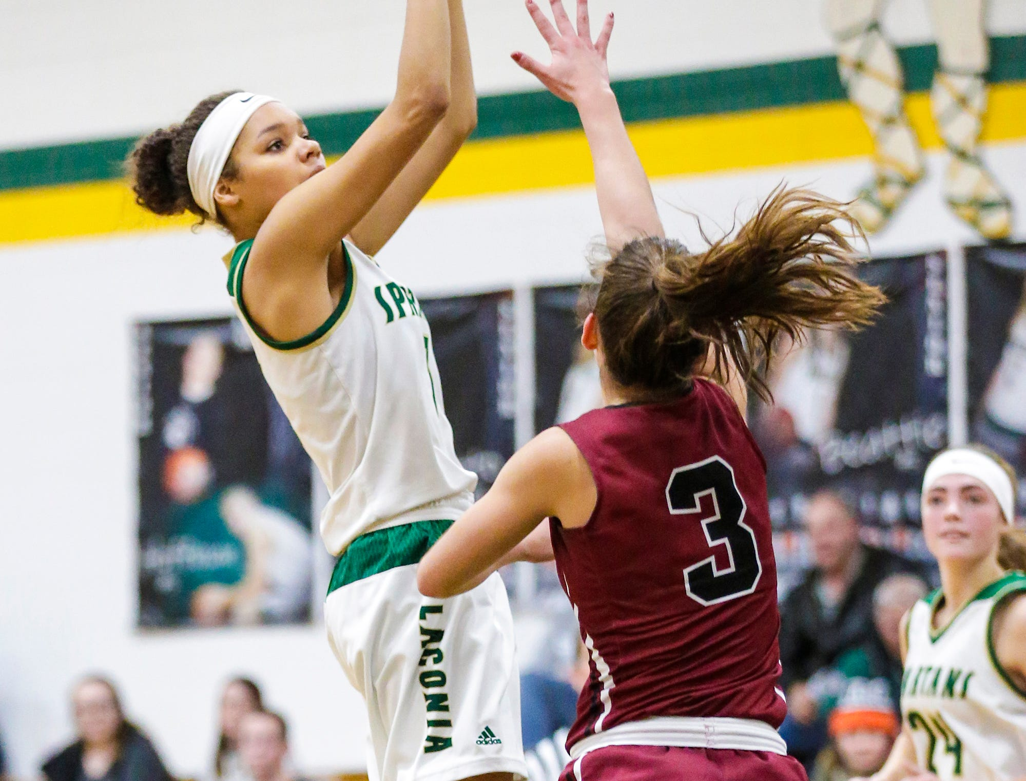 Laconia High School girls basketball's Kiarra Otto takes a shot over Mayville High School's Amber Schraufnagel during their game Friday, November 30, 2018 in Rosendale. Doug Raflik/USA TODAY NETWORK-Wisconsin