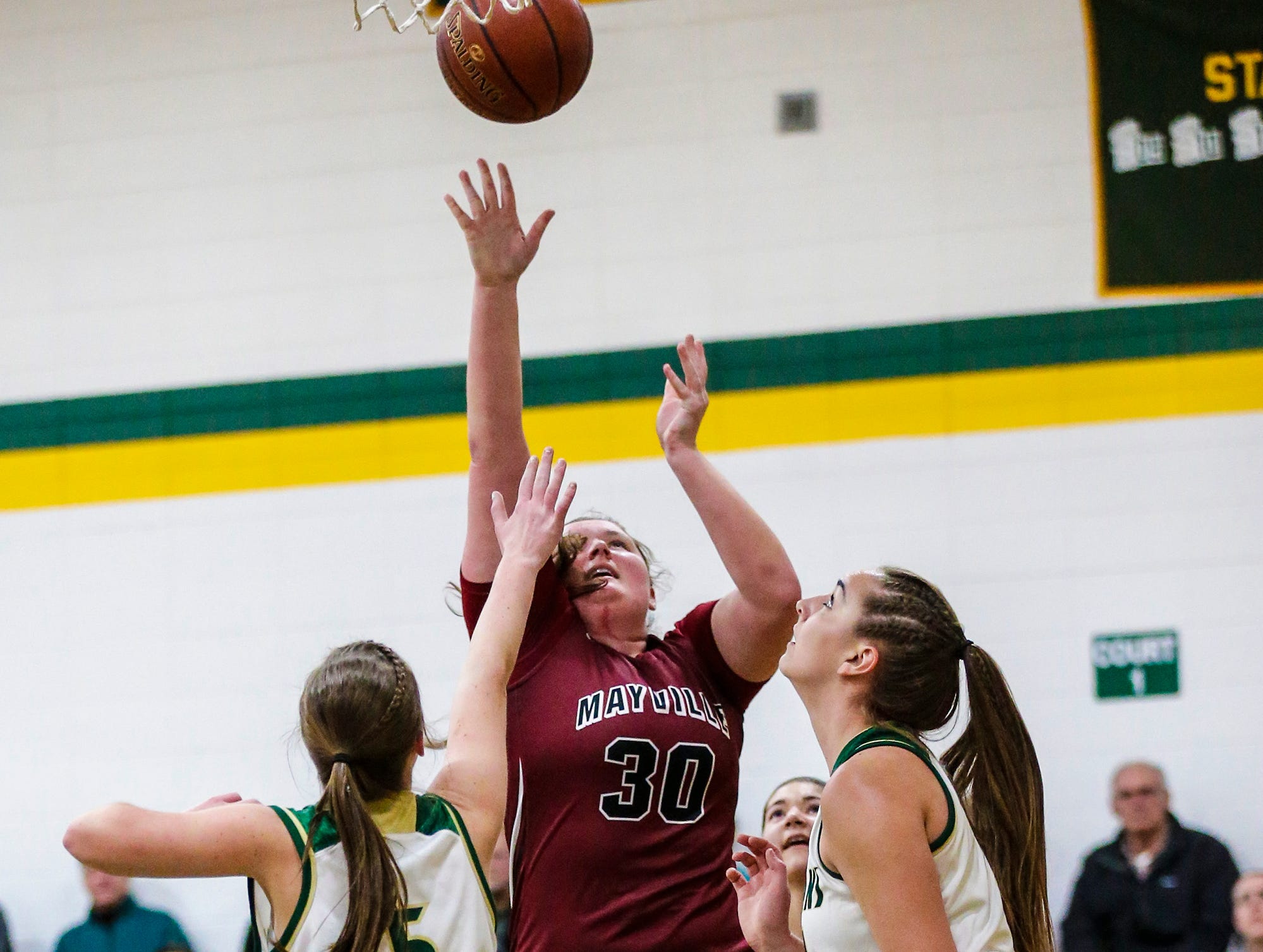 Mayville High School girls basketball's Sydney Schultz shoots a basket over Laconia High School's Jen Beattie (5) and Alissa Dins (21) during their game Friday, November 30, 2018 in Rosendale. Doug Raflik/USA TODAY NETWORK-Wisconsin