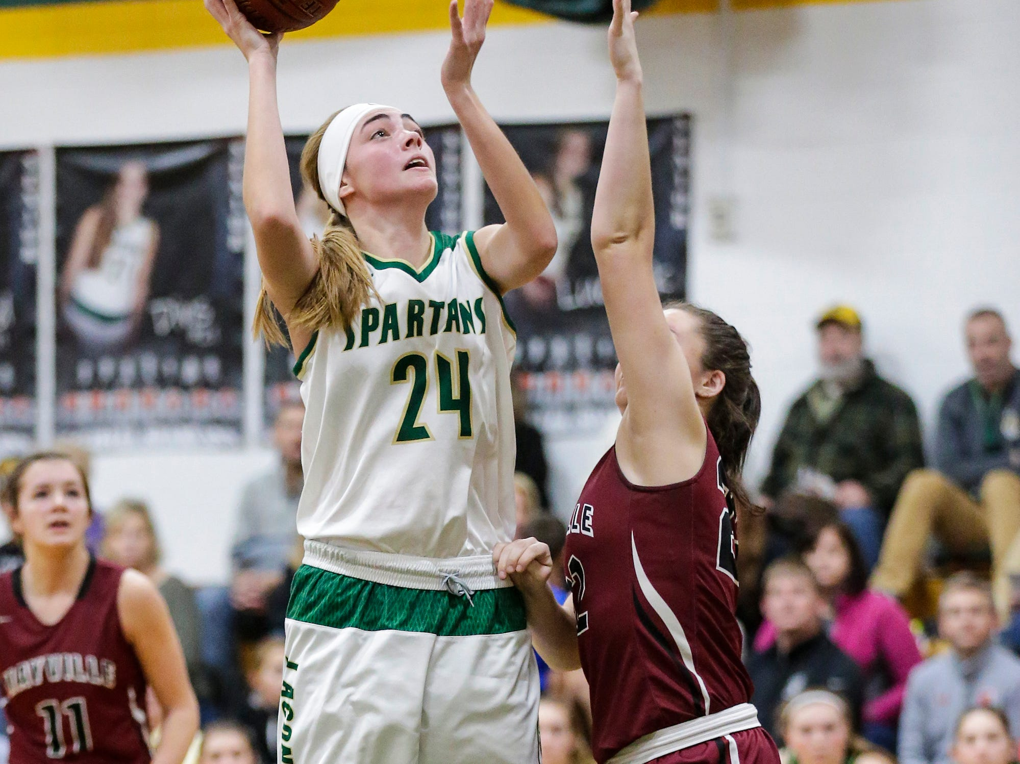 Laconia High School girls basketball's Maci Grade goes up for a basket against Mayville High School during their game Friday, November 30, 2018 in Rosendale. Doug Raflik/USA TODAY NETWORK-Wisconsin