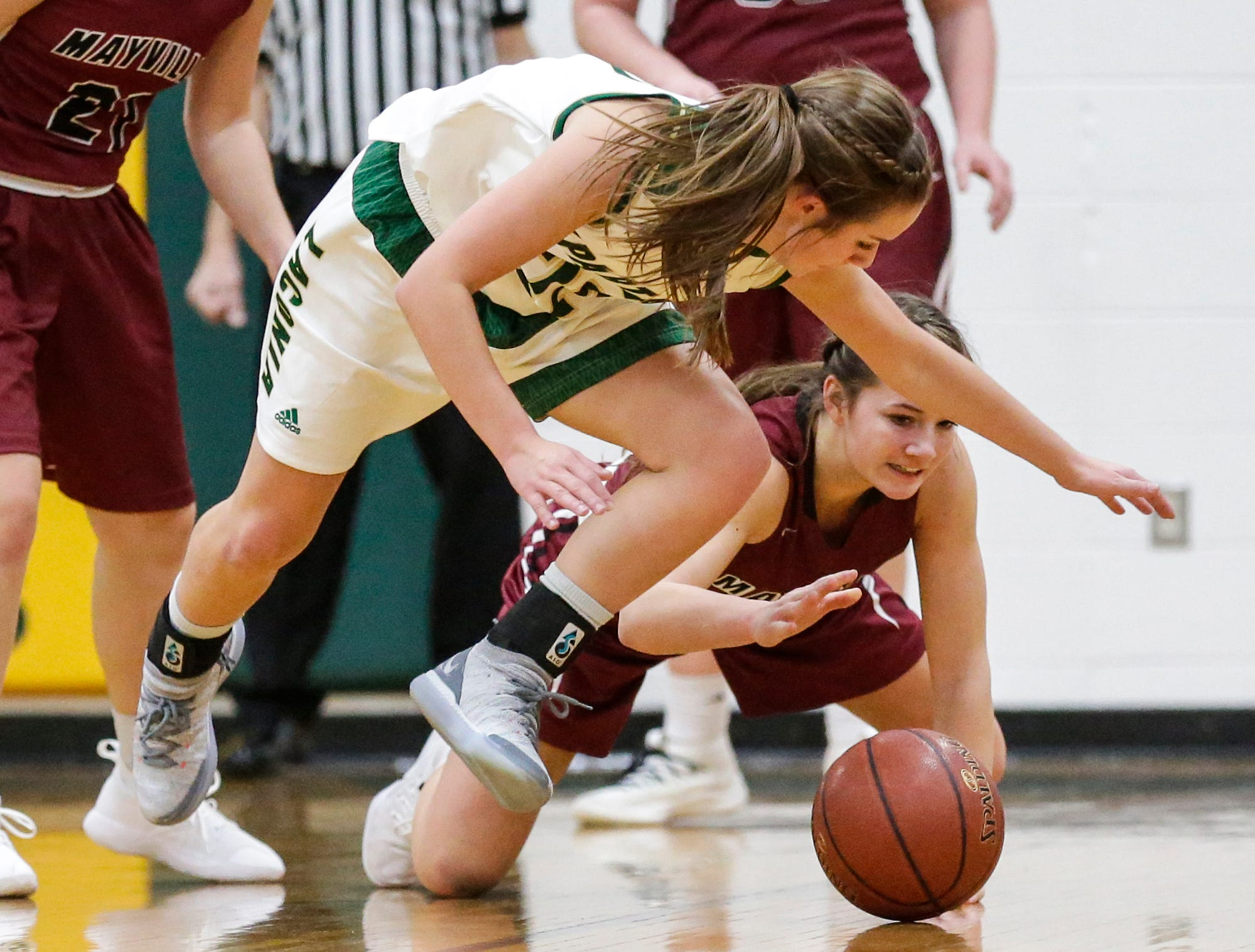 Laconia High School girls basketball's Haley Rens and Mayville High School's Whitney Liegl go after a loose ball during their game Friday, November 30, 2018 in Rosendale. Doug Raflik/USA TODAY NETWORK-Wisconsin