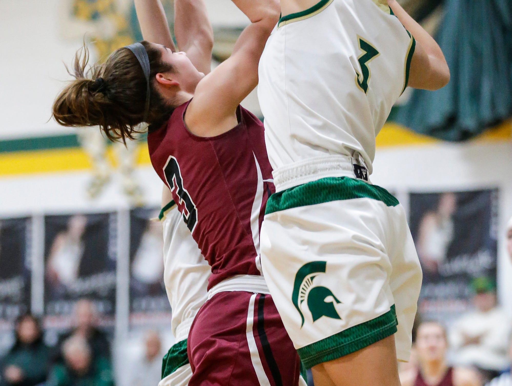 Laconia High School girls basketball's Kiarra Otto blocks a shot by Mayville High School's Amber Schraufnagel during their game Friday, November 30, 2018 in Rosendale. Doug Raflik/USA TODAY NETWORK-Wisconsin