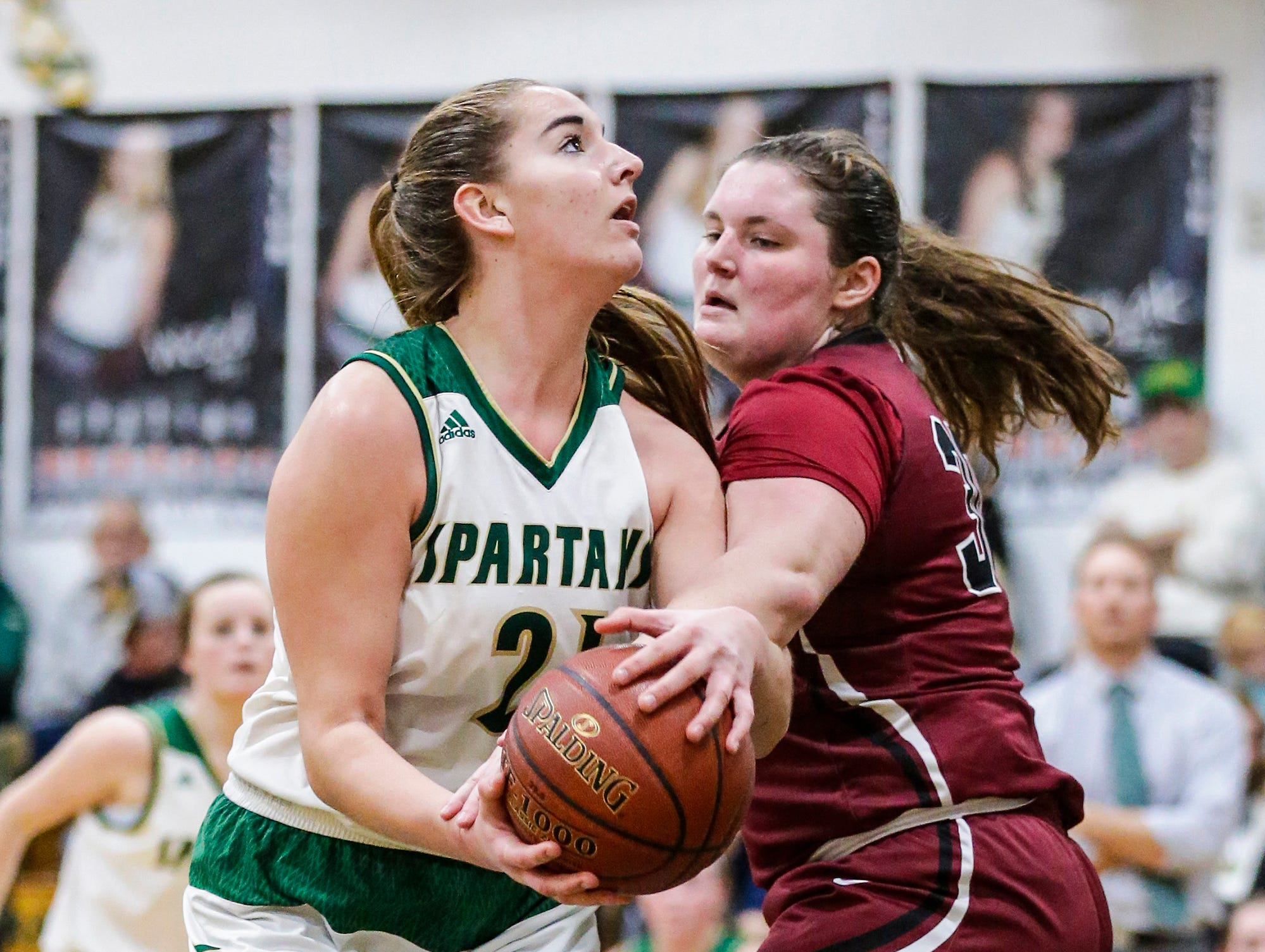 Laconia High School girls basketball's Alissa Dins gets fouled by Mayville High School's Sydney Schultz during their game Friday, November 30, 2018 in Rosendale. Doug Raflik/USA TODAY NETWORK-Wisconsin