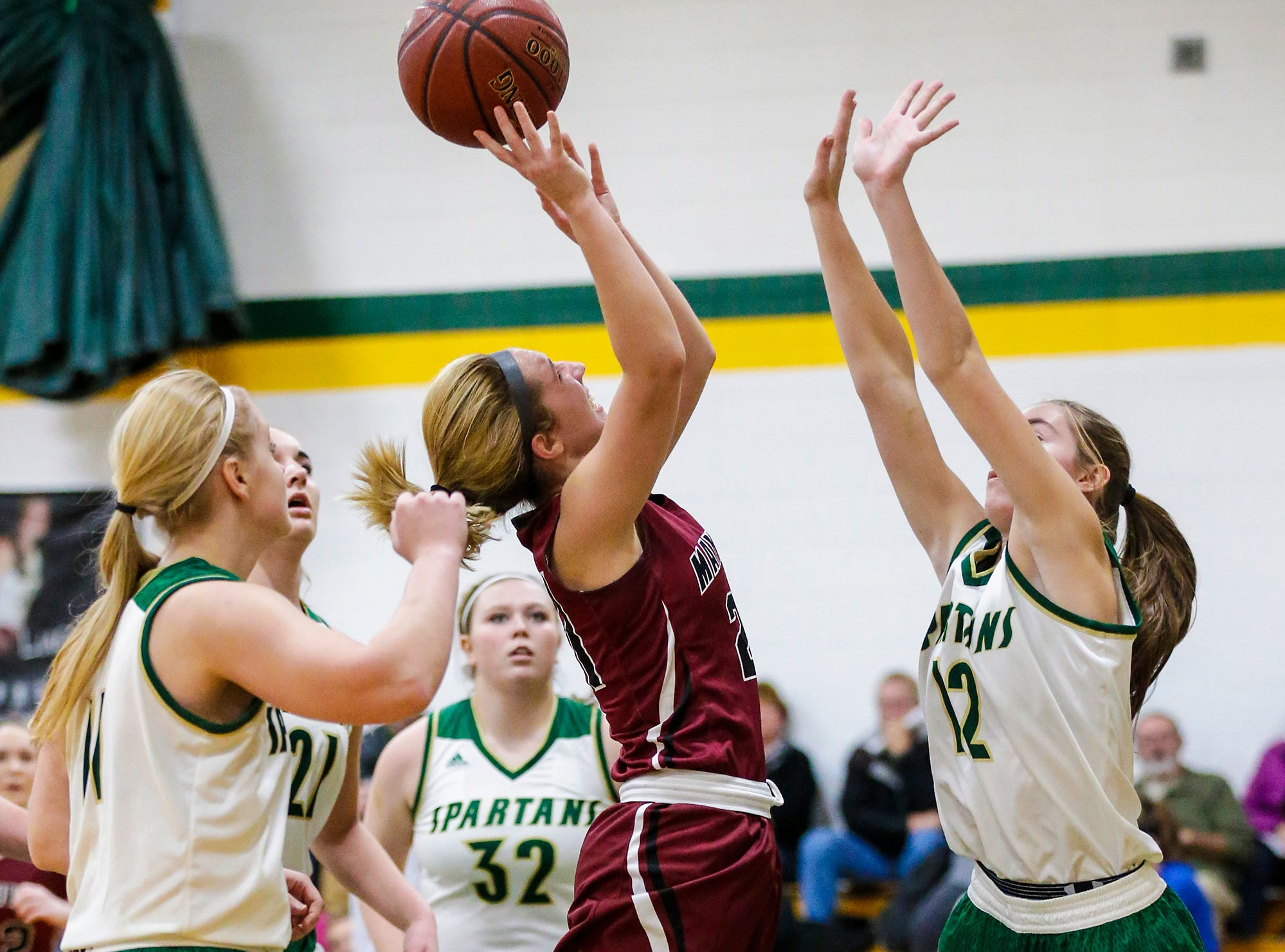 Mayville High School girls basketball's Chloe Welak goes up for a basket over Laconia High School's Lexy Smit during their game Friday, November 30, 2018 in Rosendale. Doug Raflik/USA TODAY NETWORK-Wisconsin