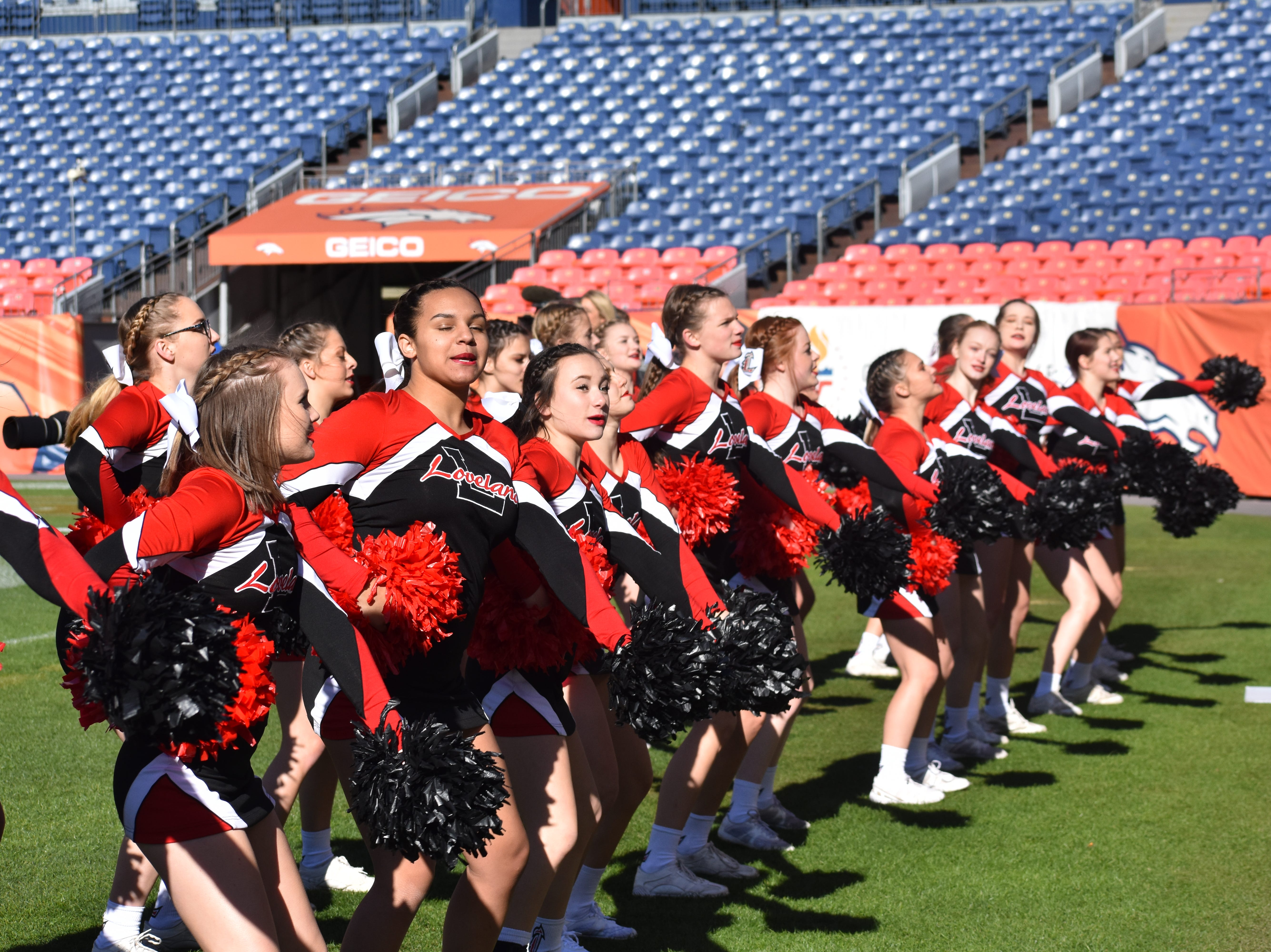 Loveland High cheerleaders during the Class 4A state championship football game Saturday at Broncos Stadium at Mile High in Denver.