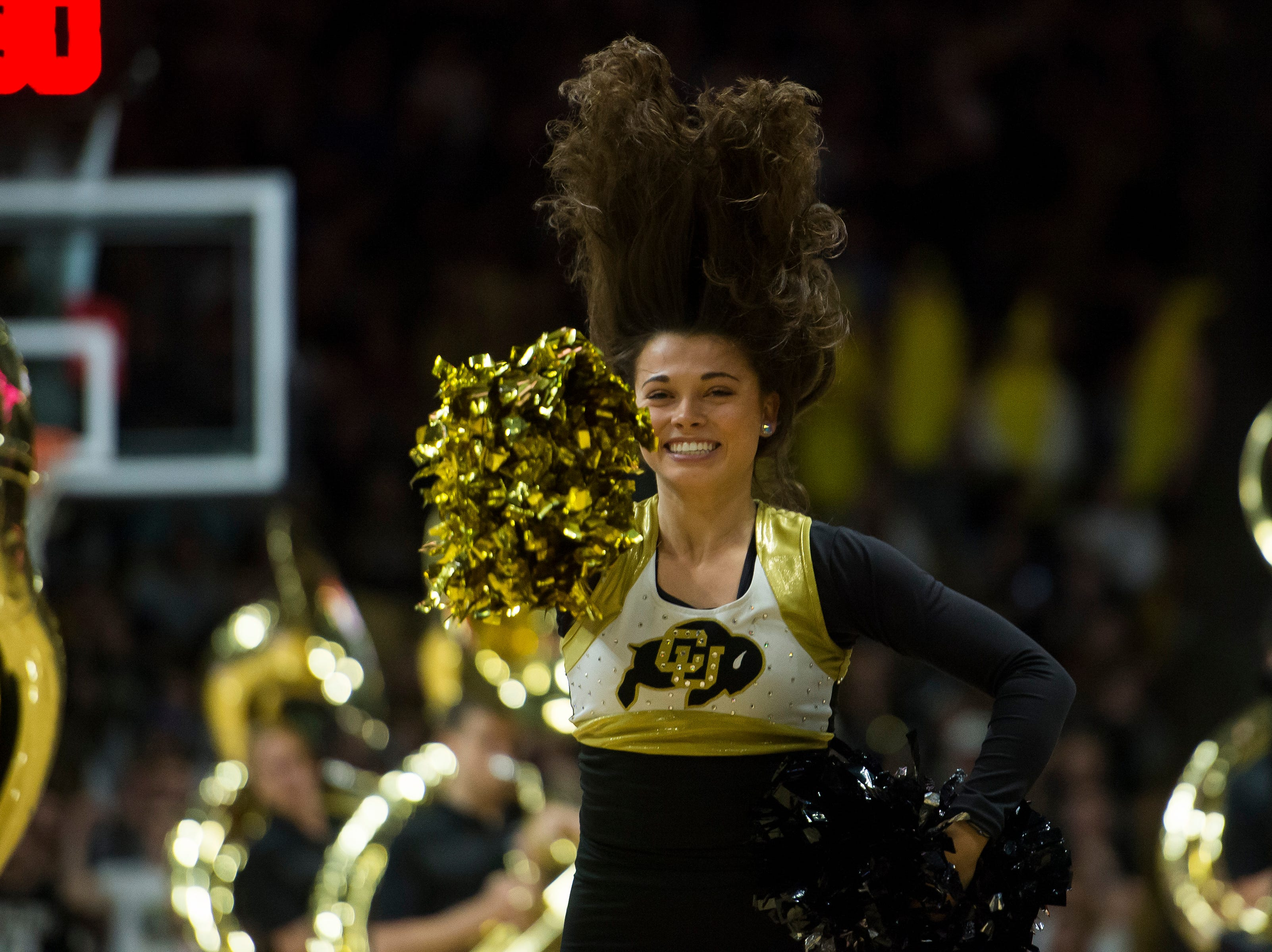 University of Colorado cheerleaders dance during a break in the action of a game against Colorado State University on Saturday, Dec. 1, 2018, at the CU Event Center in Boulder, Colo.